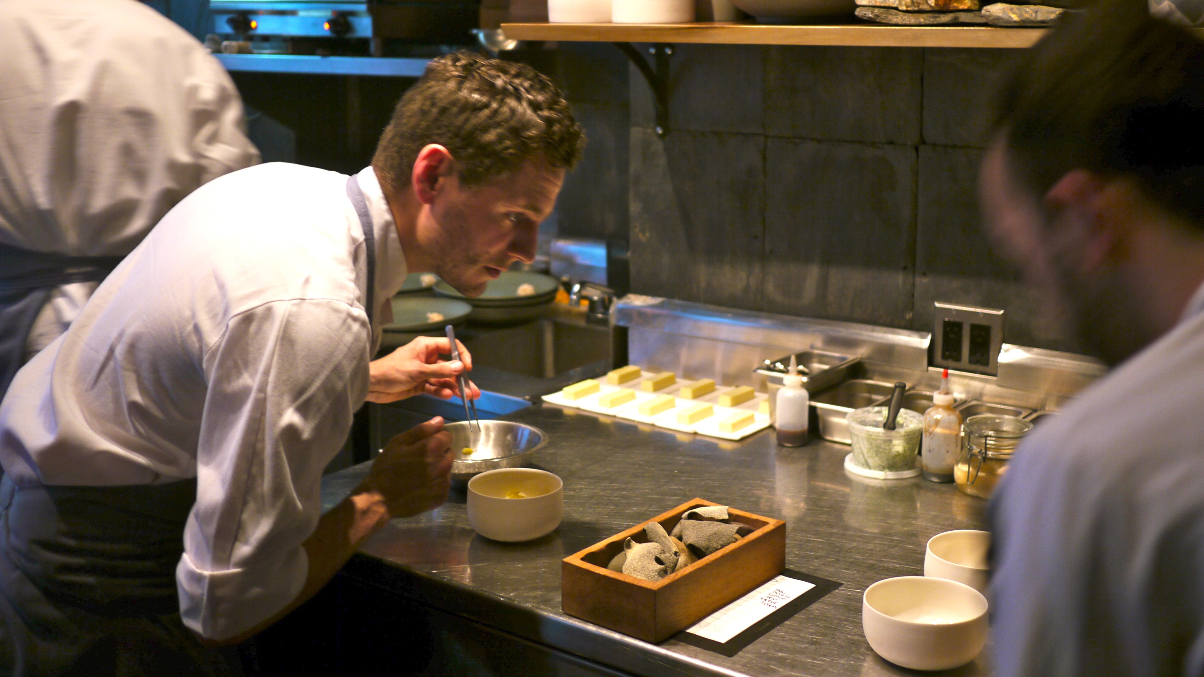 Jacob Nemmers, Atera cook, using tweezers to plate peeky-toe crab and artichokes.