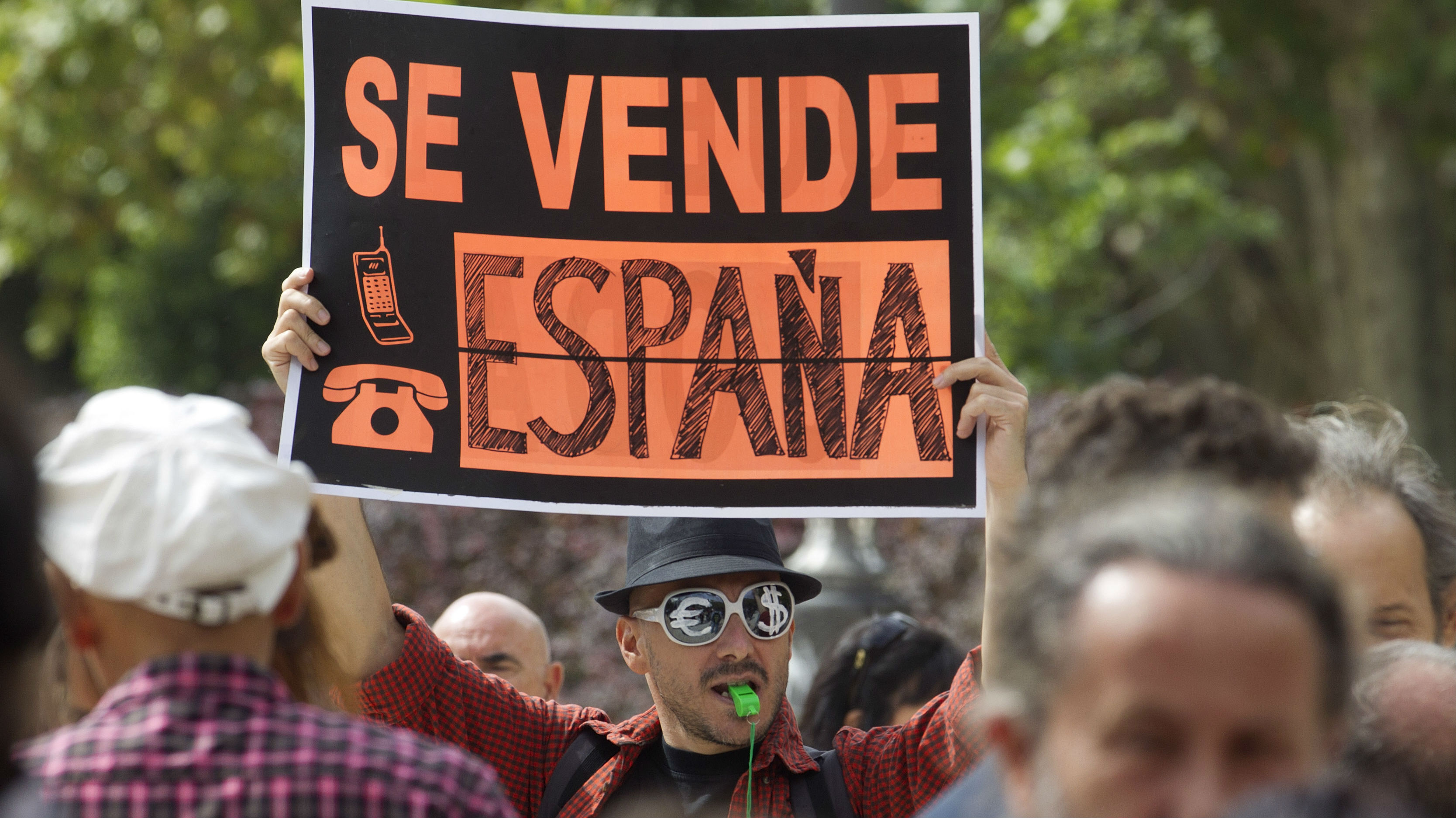 Protestor in Madrid says Spain is for sale.