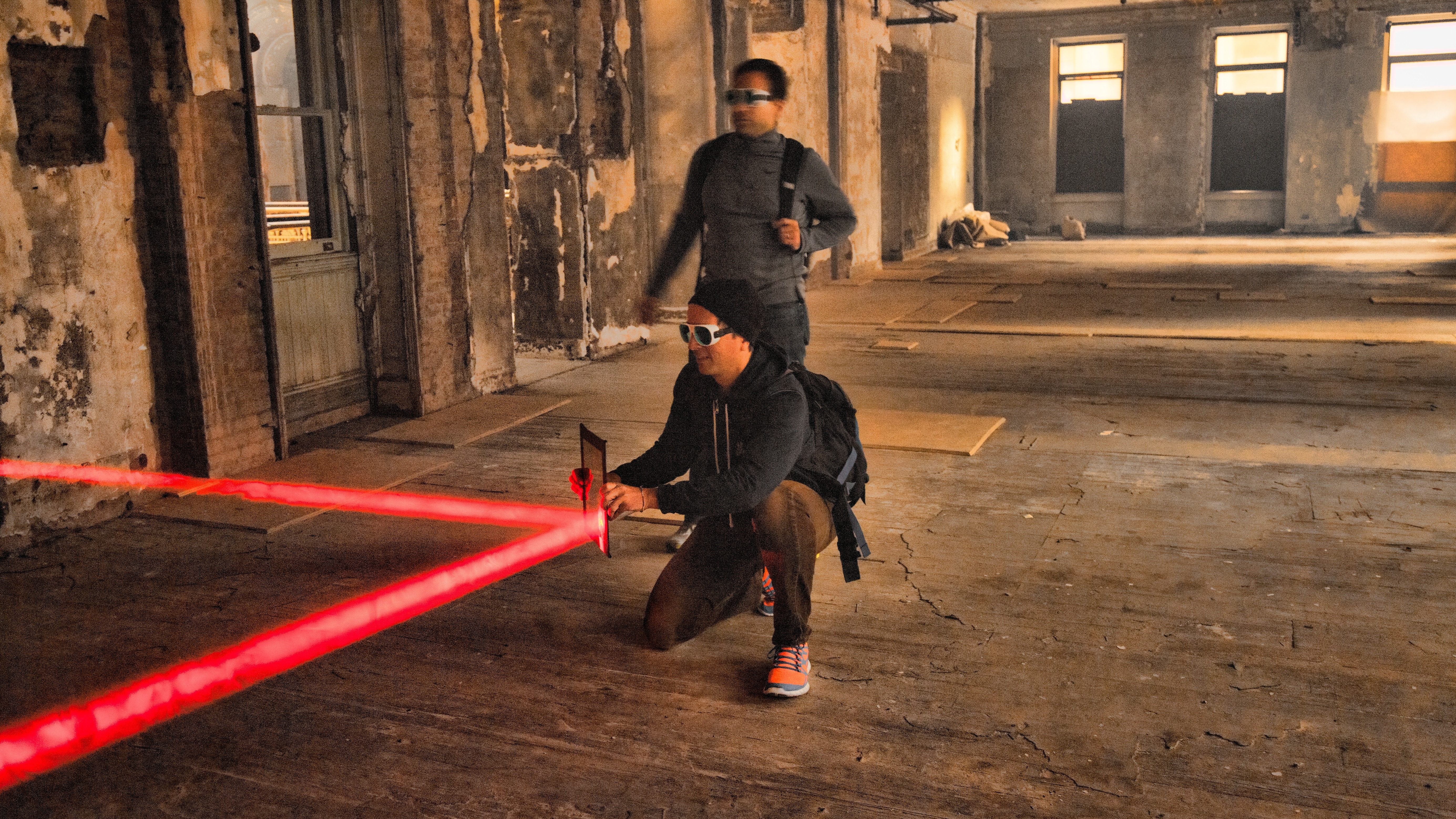 Midnight Madness XI contestants use mirrors to refract a laser onto a target.