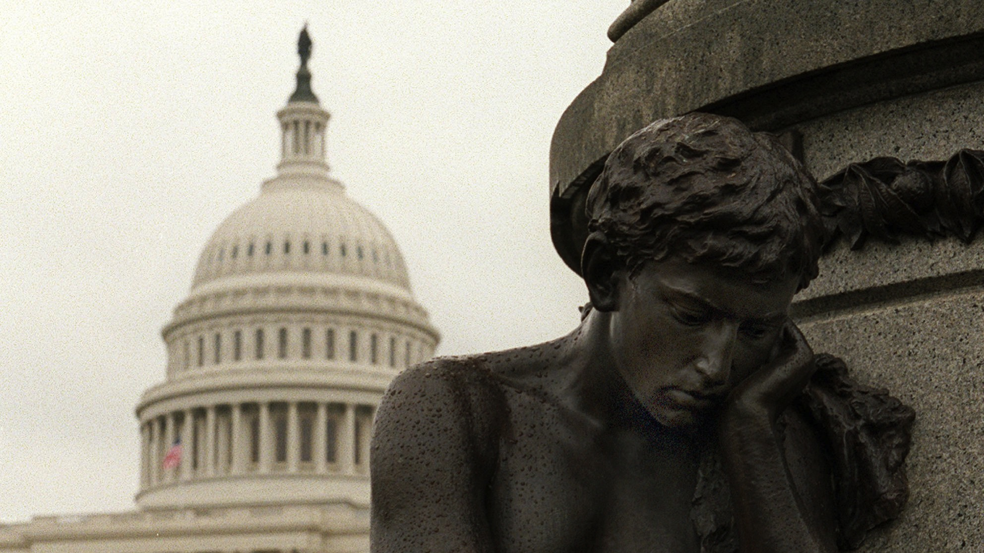 A forelorn looking sculpture sits at the base of President James A. Garfield's statue on Capitol Hill Monday Nov. 13, 1995 in anticipation to Tuesday's possible federal government shutdown. With the clock ticking toward a midnight shutdown, President Clinton vetoed a temporary borrowing bill Monday and prepared to close most government operations in a jolting political fight with Congress. (AP Photo/Ron Edmonds)