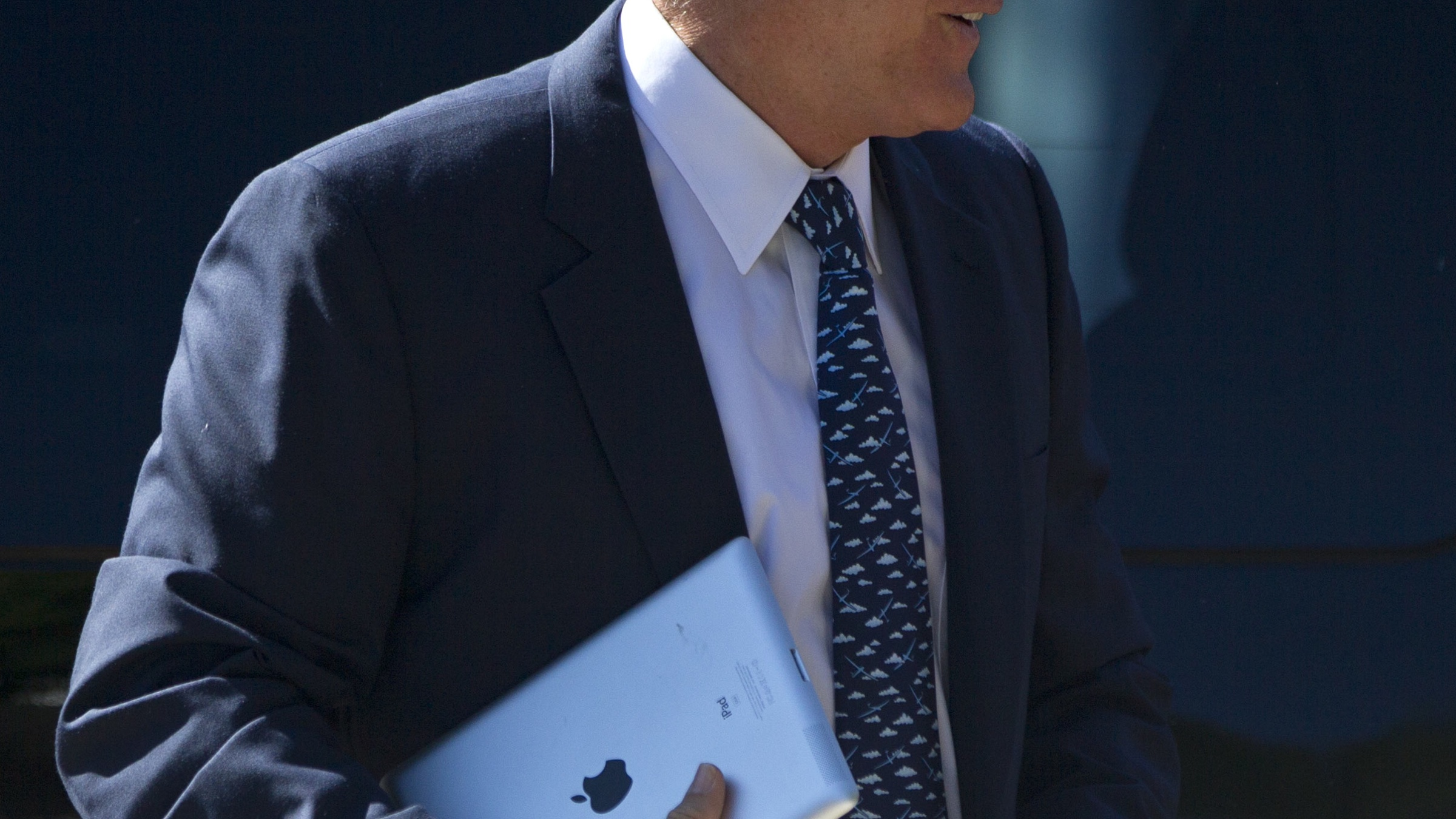 Republican presidential candidate, former Massachusetts Gov. Mitt Romney, carries an iPad as he walks into the Church of Jesus Christ of Latter-day Saints on Sunday, Aug. 19, 2012, in Wolefboro, N.H. (AP Photo/Evan Vucci)