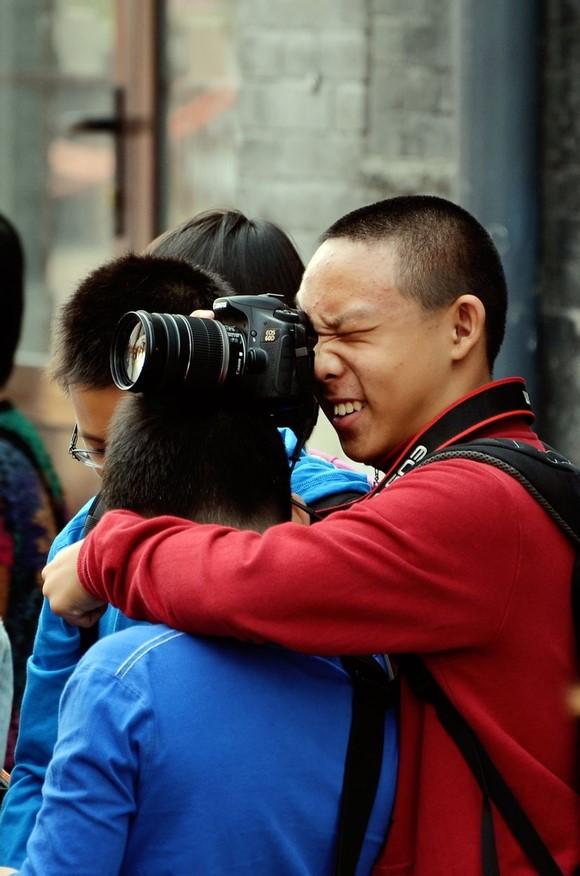 boy taking photo on someones head
