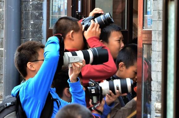 boys taking photos