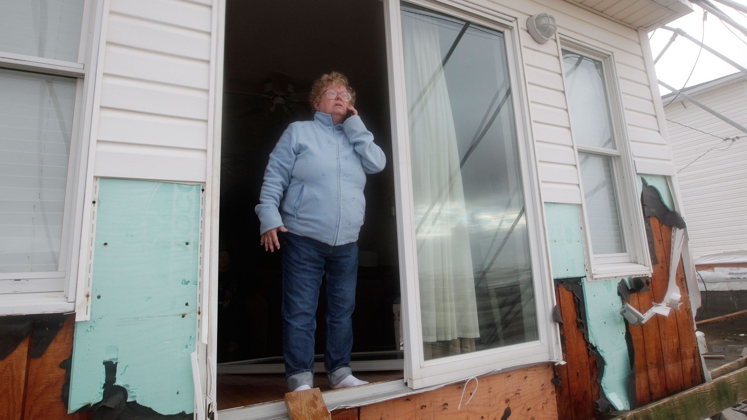 Kathy Jones calls her family after her home was damaged during Hurricane Sandy