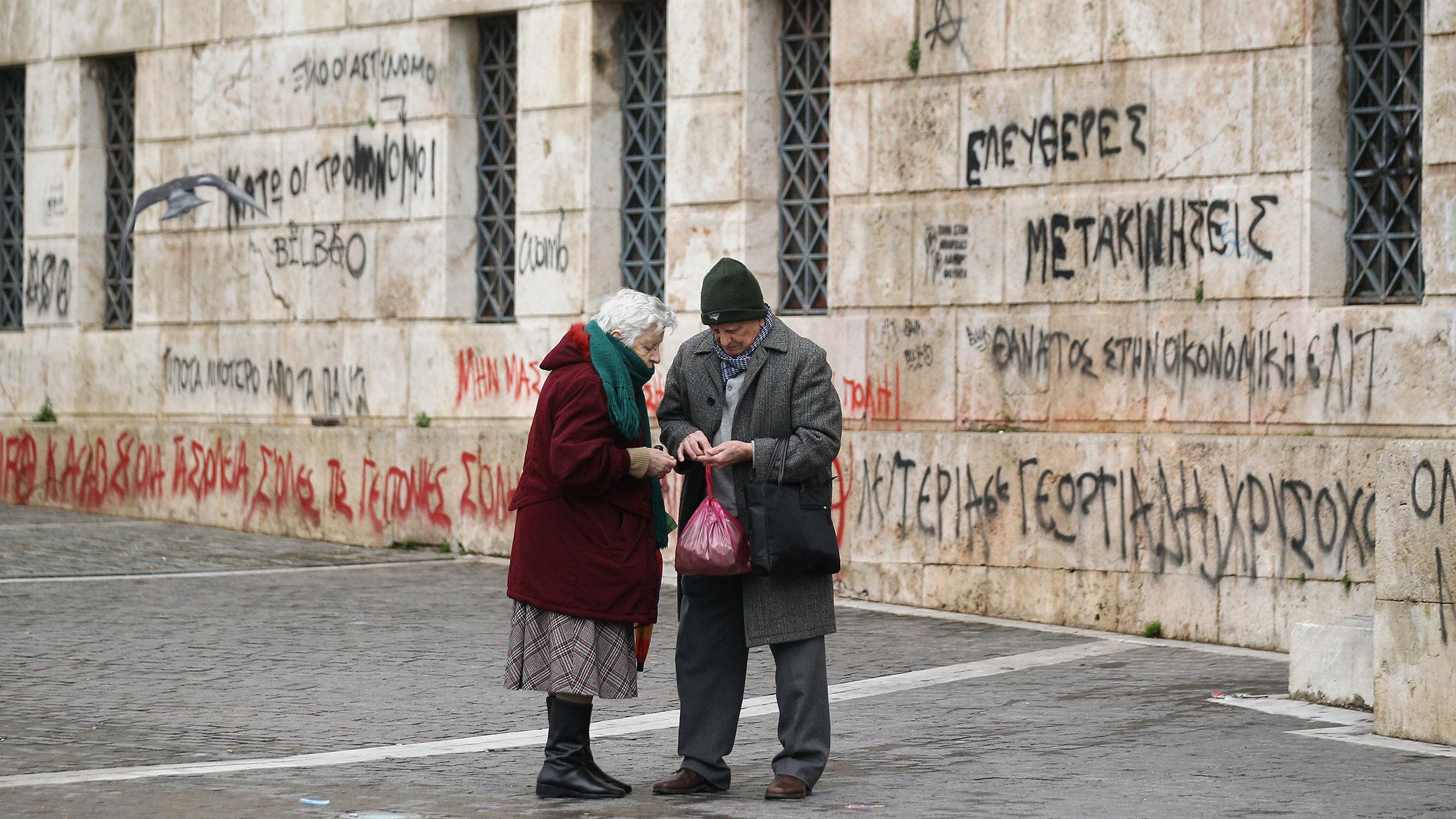 Greece Couple Money 10252012