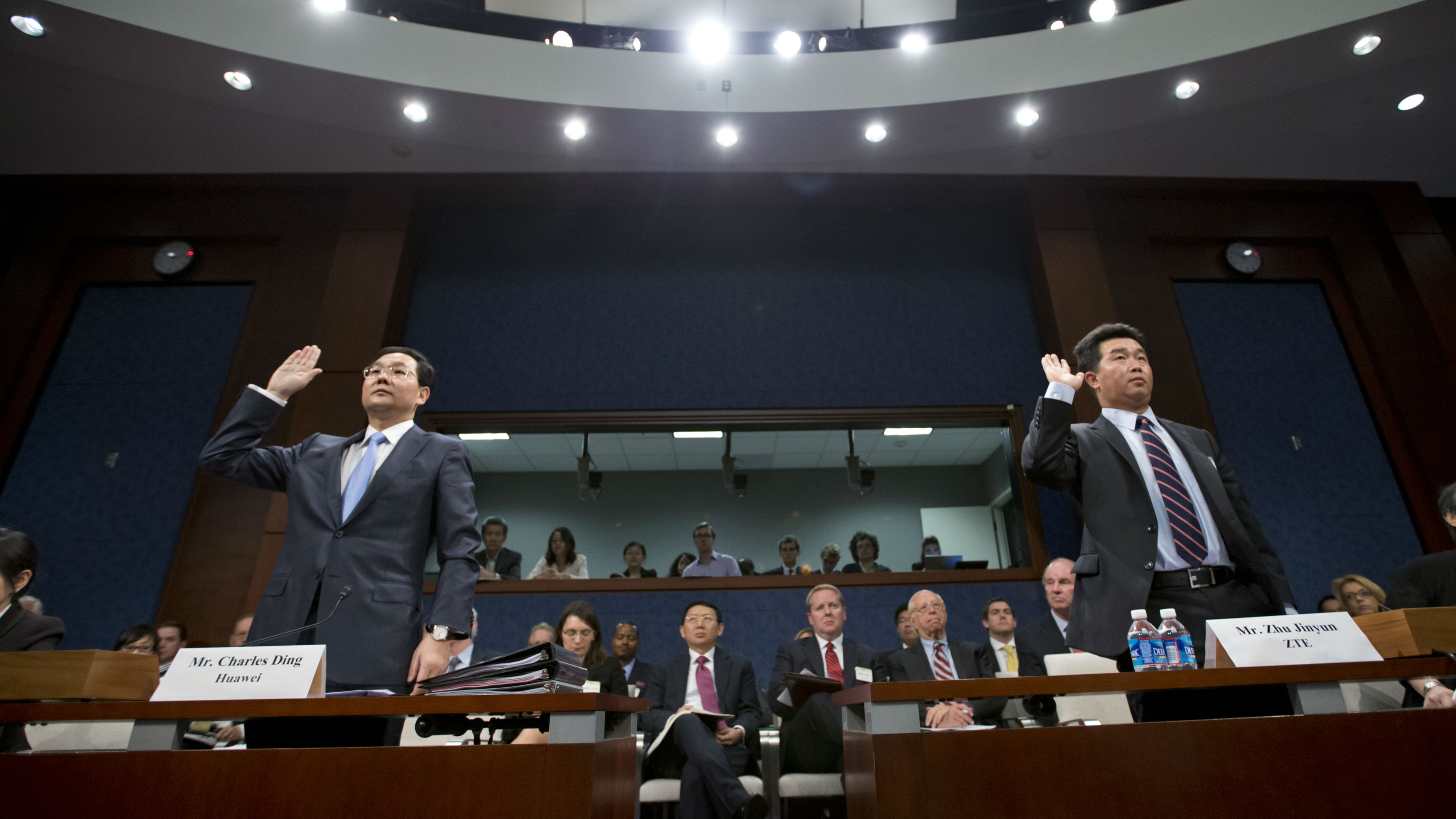Charles Ding, Huawei Technologies Ltd senior vice president for the US, left, and Zhu Jinyun, ZTE Corporation senior vice president for North America and Europe before the House Intelligence Committee on Sept. 13, 2012