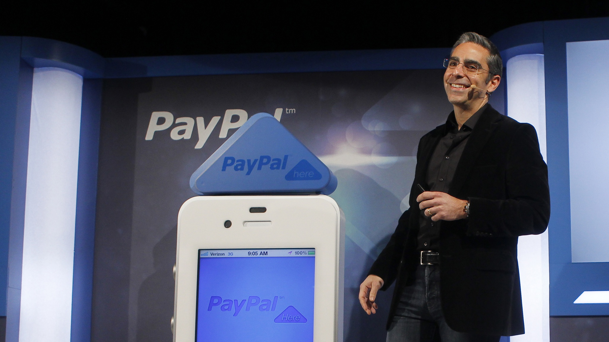 David Marcus, PayPal Vice President and General Manager of Mobile, unveils PayPal Here in San Francisco, California, March 15, 2012. PayPal Here is a free app and fully encrypted thumb-sized card reader, which turns any iPhone, and soon Android smartphone, into a mobile payment solution.  With PayPal Here, small businesses, service providers and casual sellers can send invoices or accept debit and credit cards, personal checks and PayPal using one simple product.