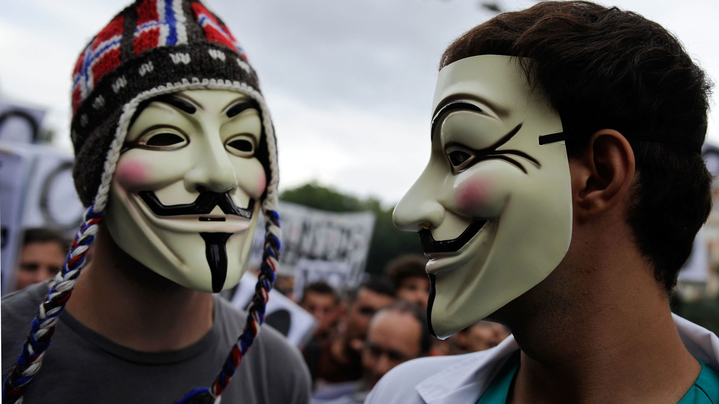 Masked demonstrators at a protest in Spain