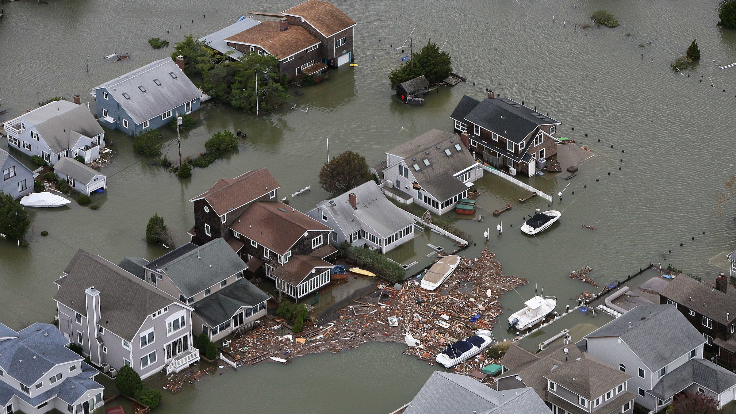 This photo made available by the New Jersey Governor's Office shows flooding and damage in Seaside, N.J. on Tuesday, Oct. 30, 2012 after superstorm Sandy made landfall in New Jersey Monday evening. (AP Photo/New Jersey Governor's Office, Tim Larsen)