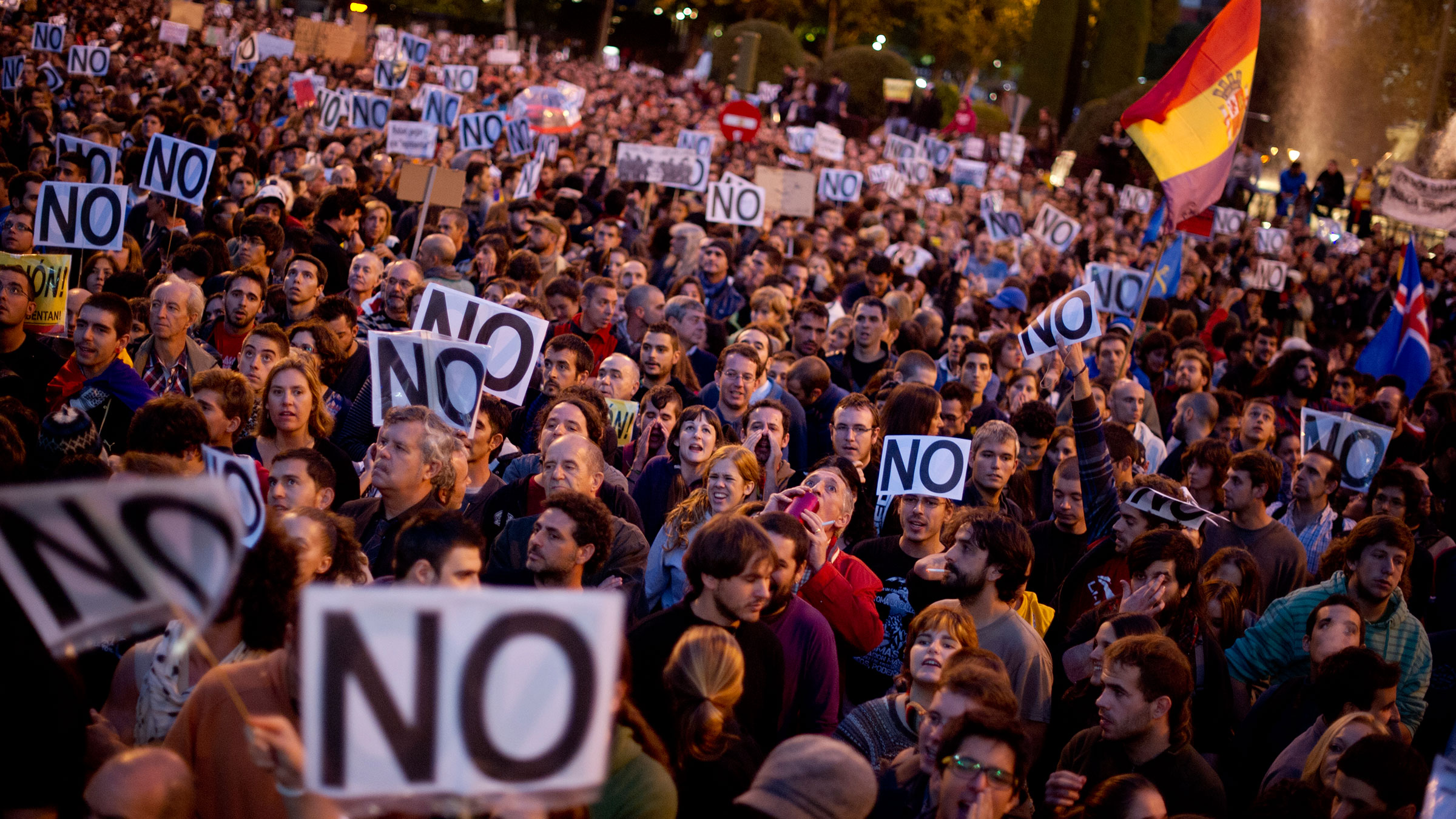MADRID, SPAIN - SEPTEMBER 29: Demonstraters shout during a protest against spending cuts and the government of Mariano Rajoy   on September 29, 2012 in Madrid, Spain. Demonstrators are protesting for the third time this week near the Spanish Parliament   against austerity measures after earlier demonstrations this week brought violence and arrests. (Photo by Jasper Juinen/Getty Images)