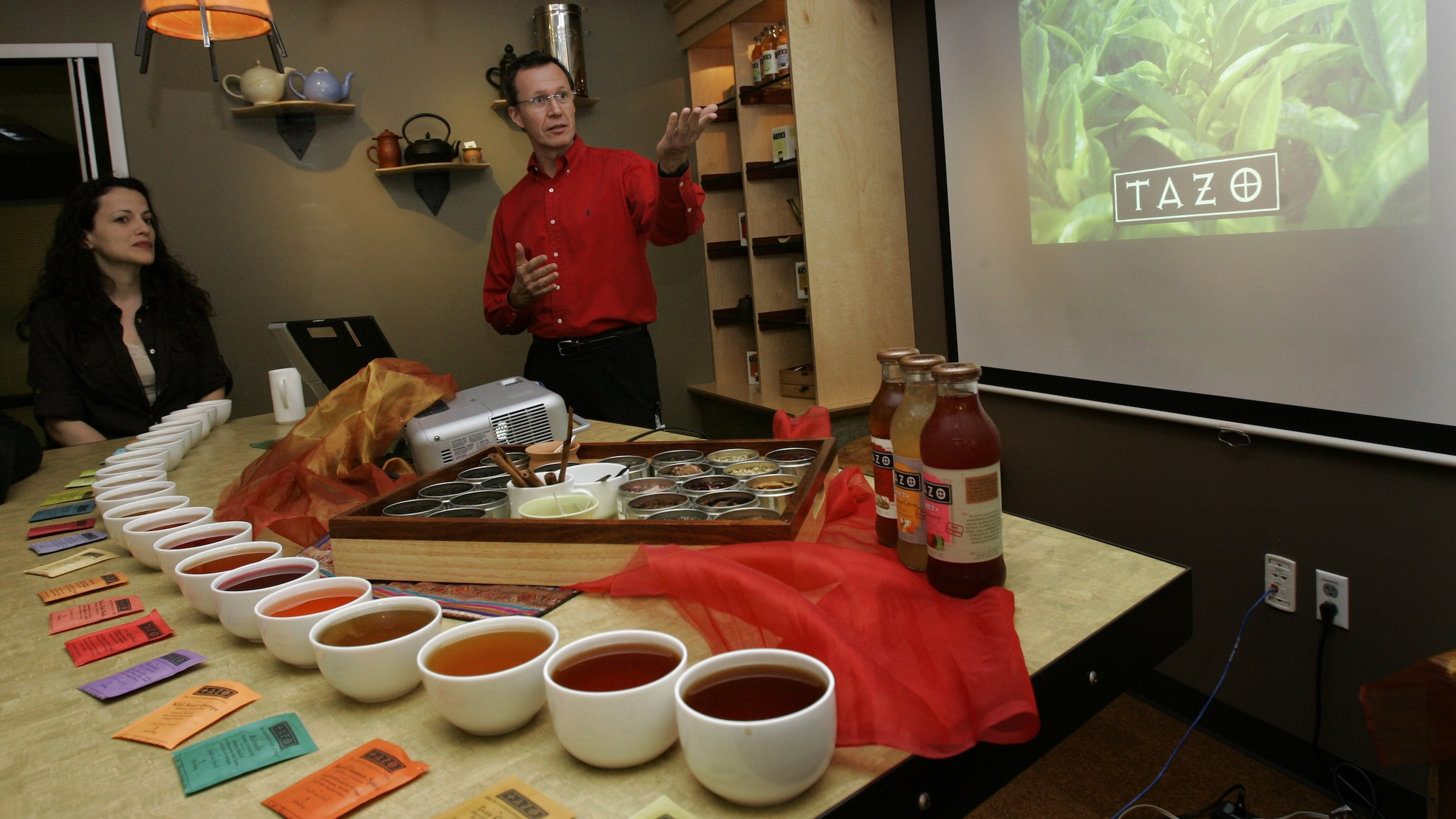 """Keith Hutjens, dirctor of tea procurement with Tazo Tea conducts a tea tasting Monday, Aug. 13, 2007 during a two-day """"Starbucks Scholars"""" media seminar at Starbucks Corp. headquarters in Seattle. Tazo is owned by Starbucks Corp. (AP Photo/Ted S. Warren)"""