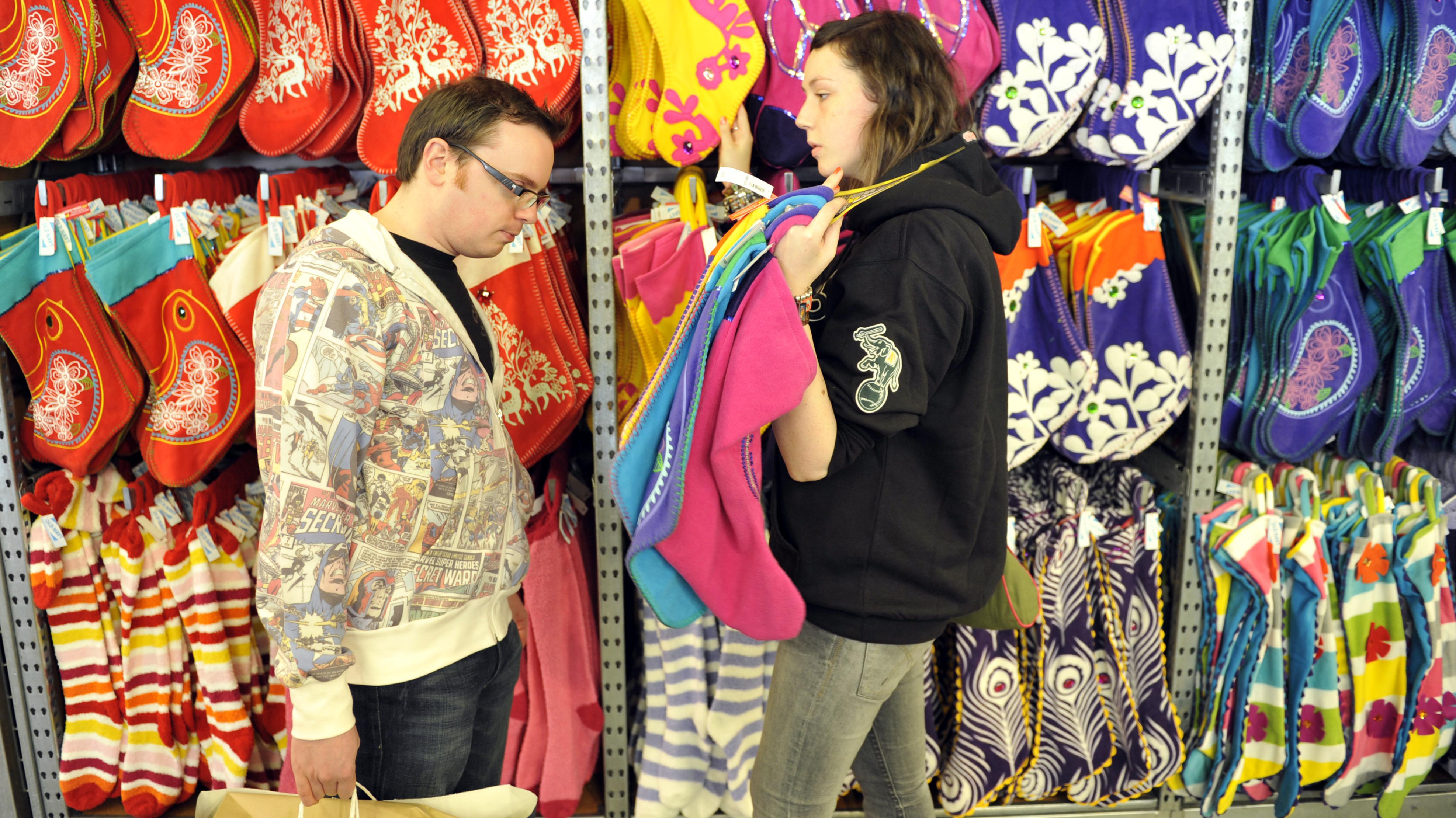 Matthew Day, left, and Esther West, both on vacation from Ireland, stock up on stockings during the Old Navy Thanksgiving sale in San Francisco, Thursday, Nov. 26, 2009. (AP Photo/Russel A. Daniels)