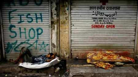 Nov. 30, 2012. A homeless man in Mumbai, India. The country's economic growth is a a three-year low.