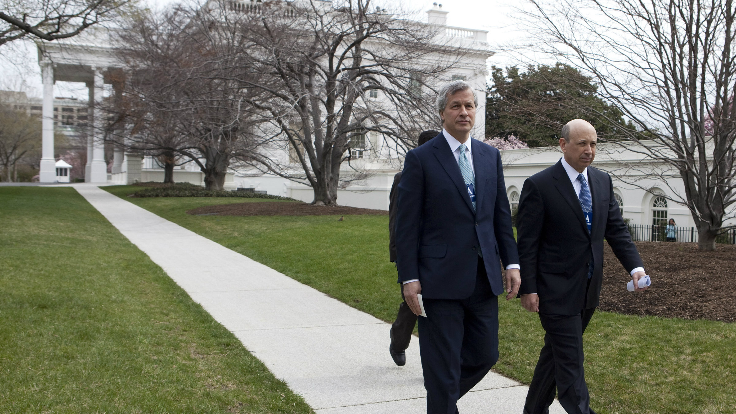 Lloyd Blankfein, pictured right, leaving the White House with JP Morgan CEO Jamie Dimon. Neither will be there today.