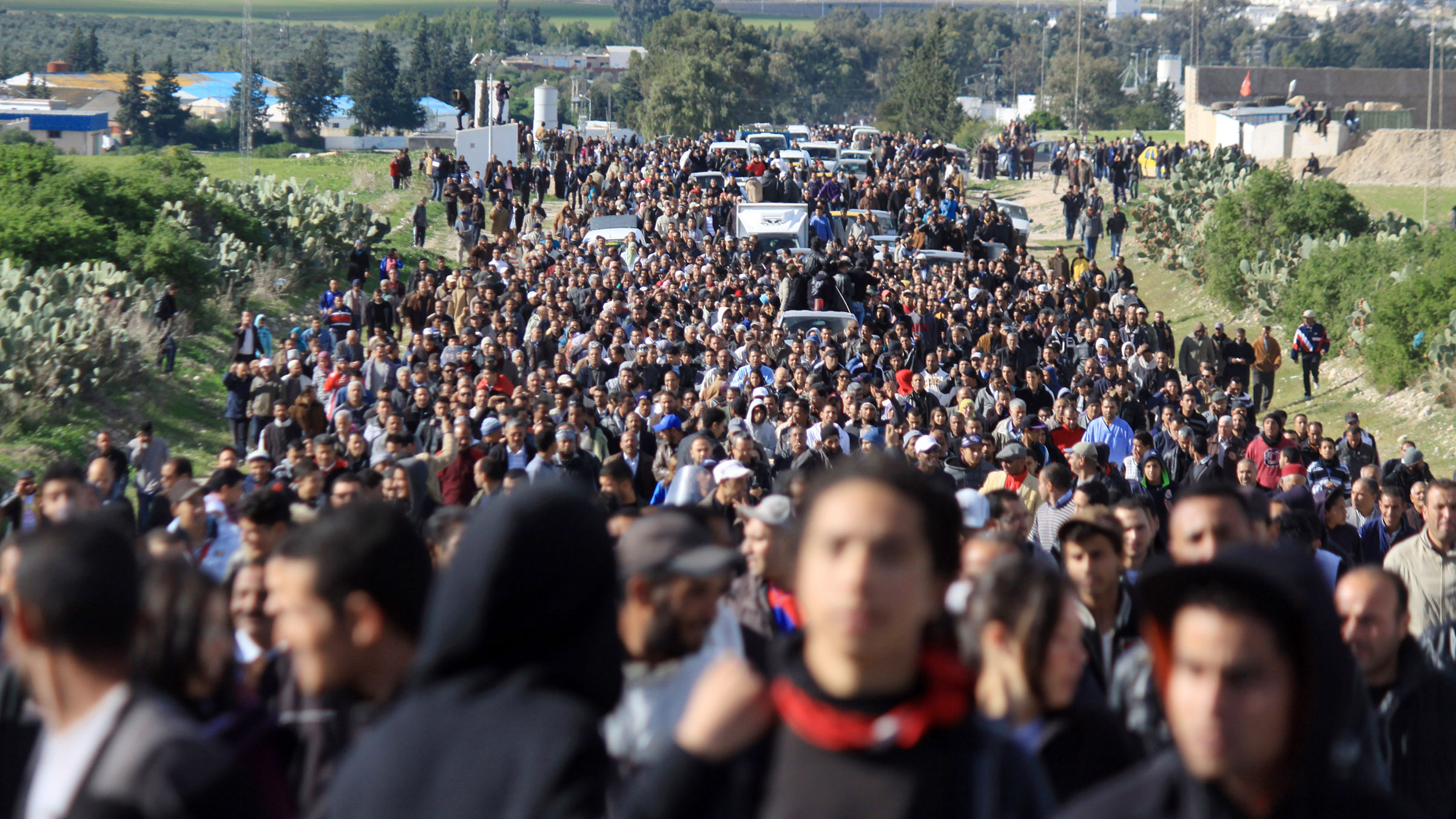Nov. 30, 2012. Demonstrators in Sillana, Tunisia, gather to walk to Tunis. Tunisia's Prime Minister accused opposition parties and unions Thursday of provoking three days of violent clashes in Siliana and pleaded for patience while the government tackles the nation's economic problems.