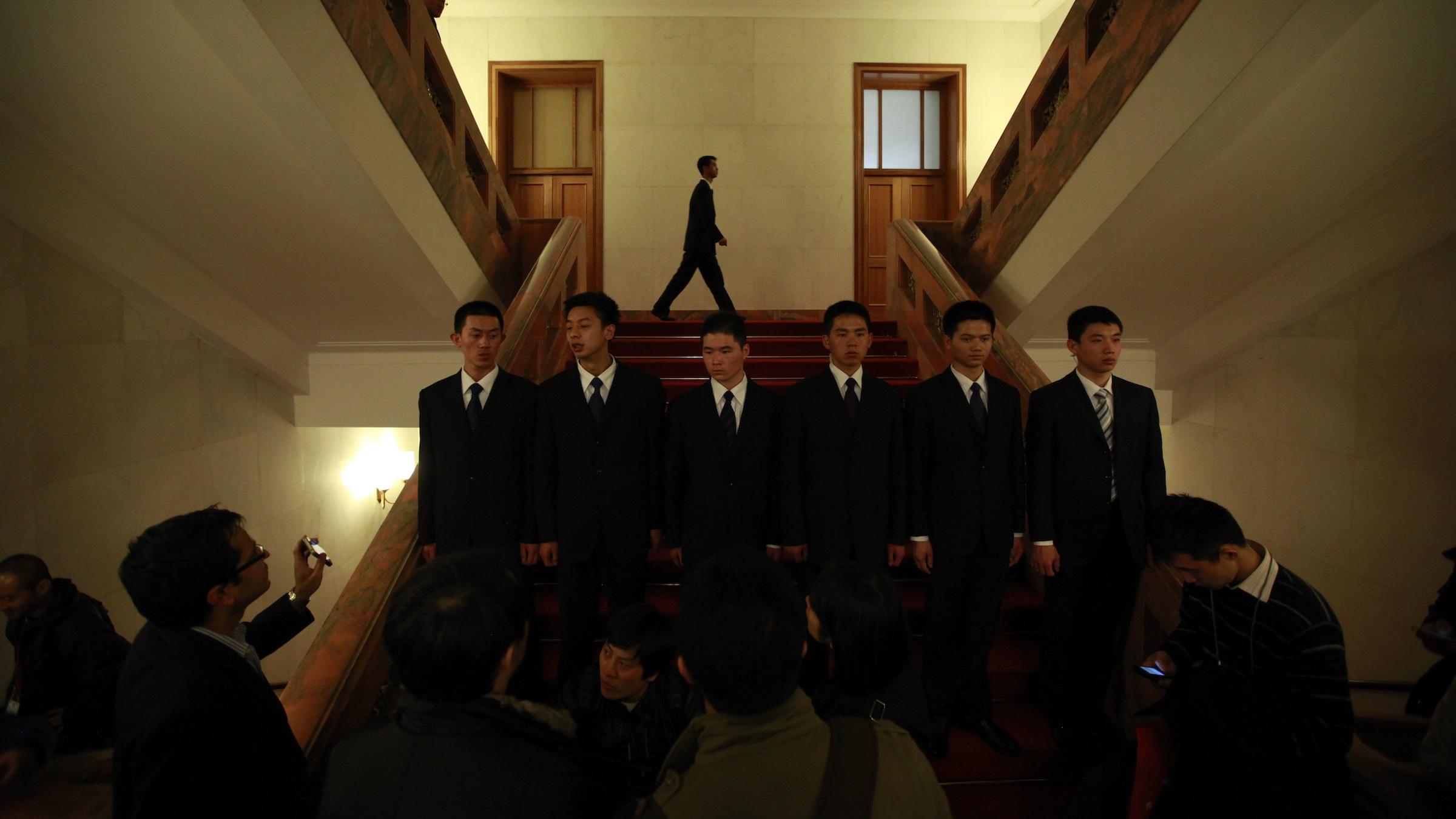 Security guards at Gu Kailai's trial in Chongqing.