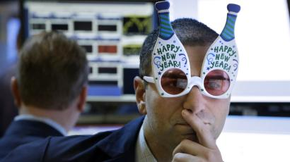 "A trader wearing ""Happy New Year"" glasses at the NYSE"