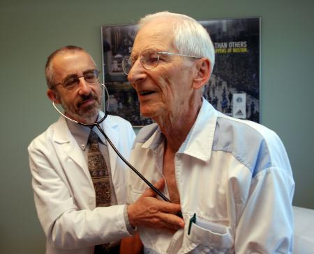 doctor examines patient cliff