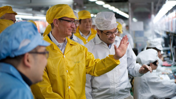 The offshoring winner's circle: Highly-skilled American workers like Apple CEO Tim Cook and low-skilled Chinese workers, like these FoxConn employees.
