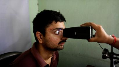 An Indian gets his retina scan done as he enrolls for Aadhar, India's unique identification project in Kolkata, India, Wednesday, May 16, 2012.The giant identification project which aims to give everyone an identity record and number for the first time involves recording retina scans, fingerprints and photographs of all 1.2 billion Indians.