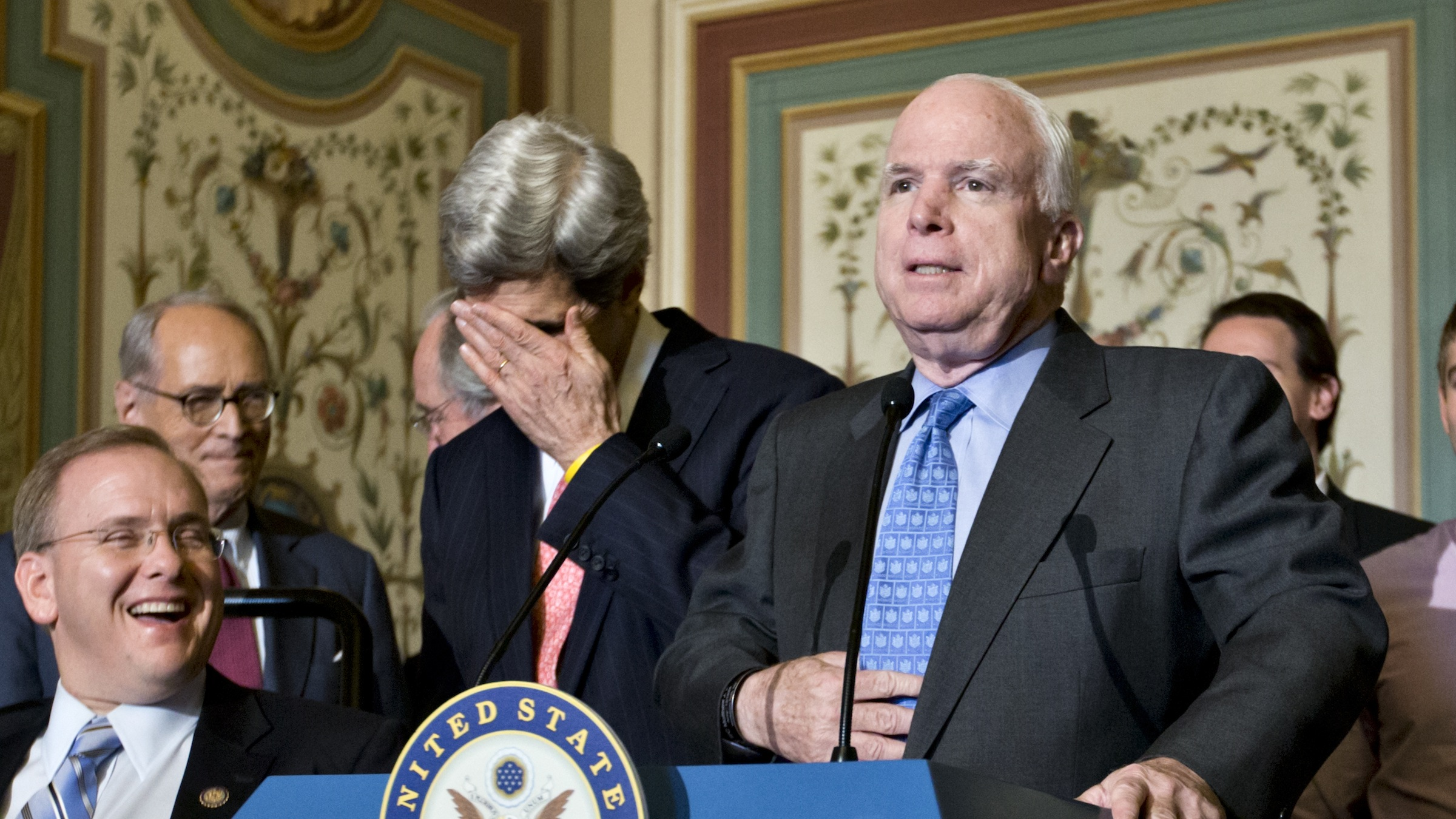 """Sen. John Kerry, D-Mass., left center, reacts as Sen. John McCain, R-Ariz., center, has some fun at the expense of his friend and Democratic colleague during a news conference on Capitol Hill in Washington, Monday, Dec. 3, 2102, on a disabilities treaty. Responding to a Kerry introduction at a news conference on a disabilities treaty, McCain said, """"thank you very much, Mr. Secretary,"""" a reference to the recent talk that Kerry is a top candidate to replace Secretary of State Hillary Rodham Clinton. """"Thank you very much Mr. President,"""" Kerry said later when he returned to the microphone to McCain, who unsuccessfully sought the presidency in 2000 and 2008. From left are, Rep. Jim Langevin, D-R.I., former Attorney General Richard Thornburgh, Sen. Tom Harkin, D-Iowa, Kerry and McCain.   (AP Photo/J. Scott Applewhite)"""