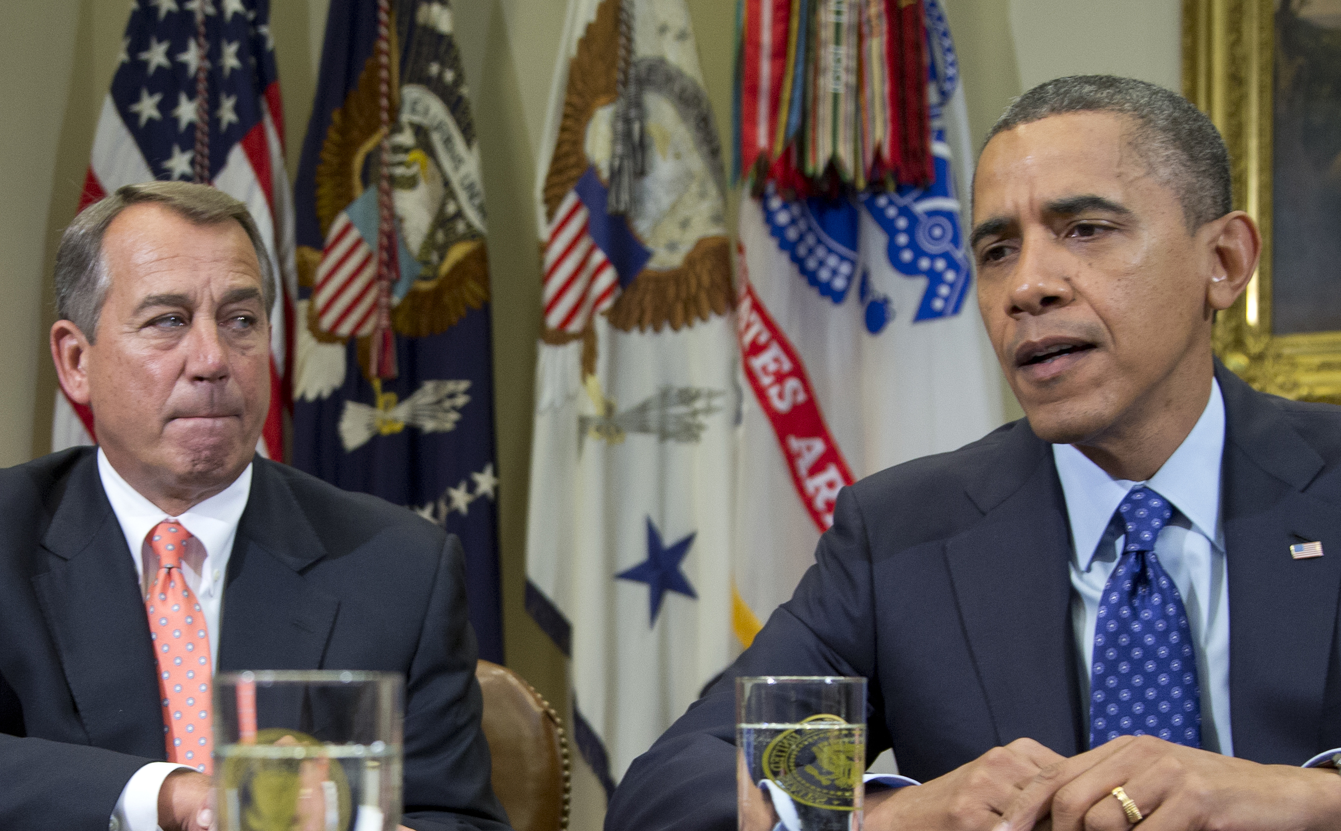 FILE - This Nov. 16, 2012 file photo shows President Barack Obama, accompanied by House Speaker John Boehner of Ohio, speaking to reporters in the Roosevelt Room of the White House in Washington. Even if Congress and the White House fail to strike a budget deal by New Year's Day, reality may be a lot less bleak then the scenario that's been spooking employers and investors and slowing the U.S. Economy. The tax increases and spending cuts could be retroactively repealed after Jan. (AP Photo/Carolyn Kaster, File)