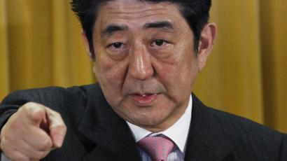 Japan's Liberal Democratic Party President Shinzo Abe points a reporter during a question and answer during a press conference at the party headquarters in Tokyo Monday, Dec. 17, 2012, a day after the party's landslide victory over the ruling Democratic Party of Japan led by Prime Minister Yoshihiko Noda in parliamentary elections. Abe stressed Monday that the road ahead will not be easy as he tries to revive Japan's sputtering economy and bolster its national security amid deteriorating relations with China.