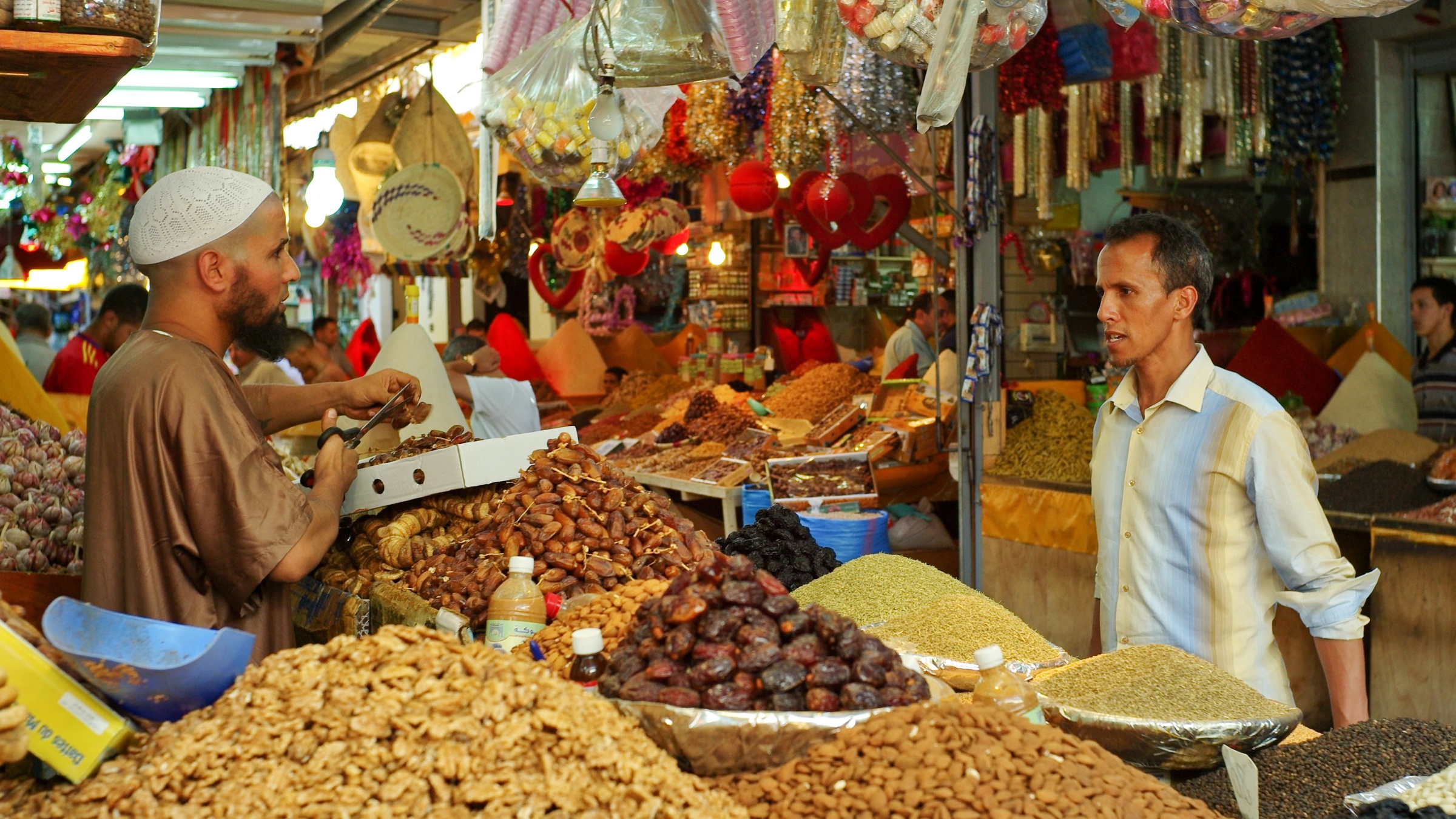A man buys dates in a souk market in Casablanca in preparation for breaking the Ramadan fast during the first day of the holy fasting month of Ramadan in Casablanca, Morocco, Saturday, July 21, 2012.  (AP Photo/Abdeljalil Bounhar)