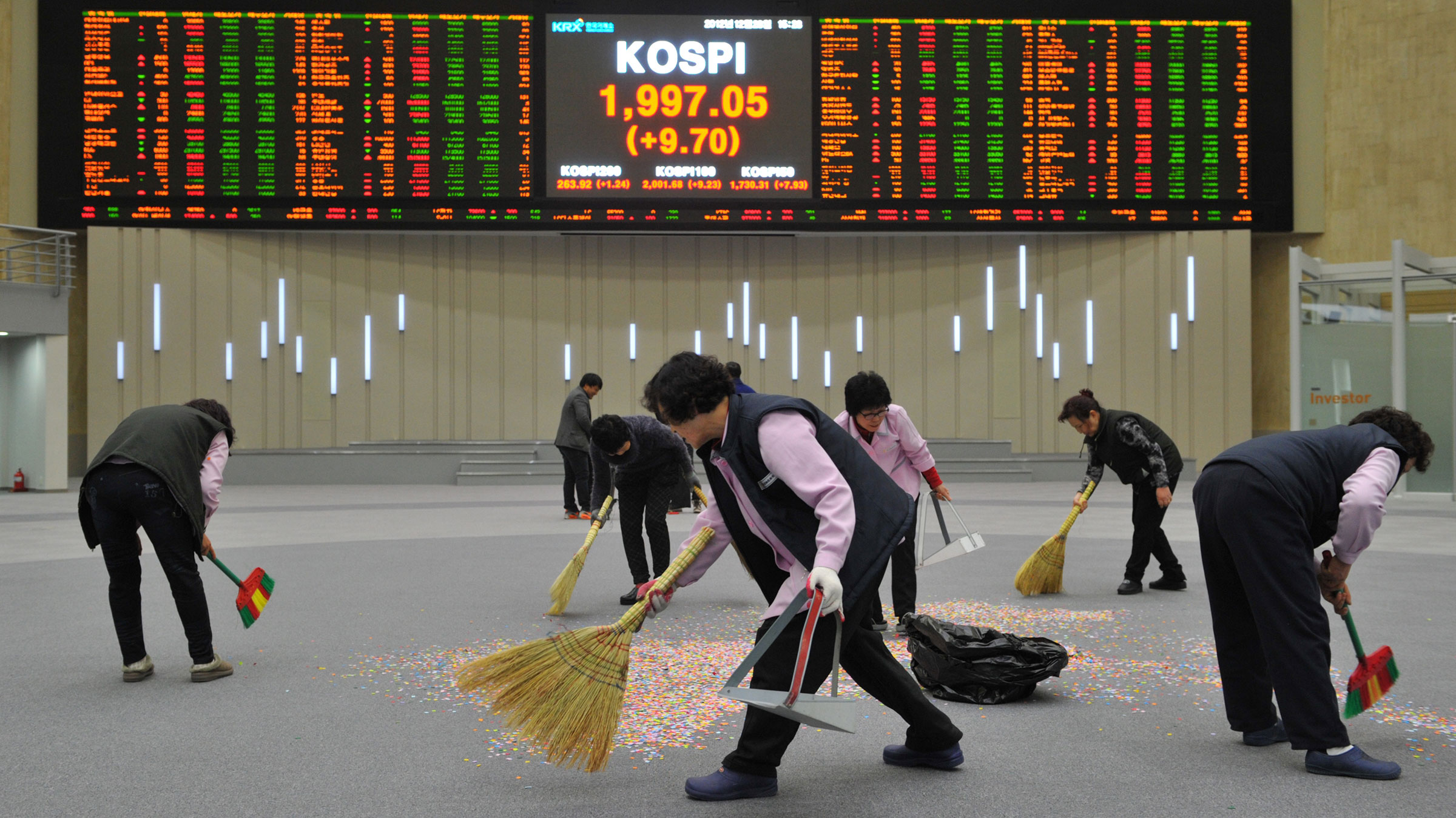 Sweeping confetti after the last trading day of the year in Seoul
