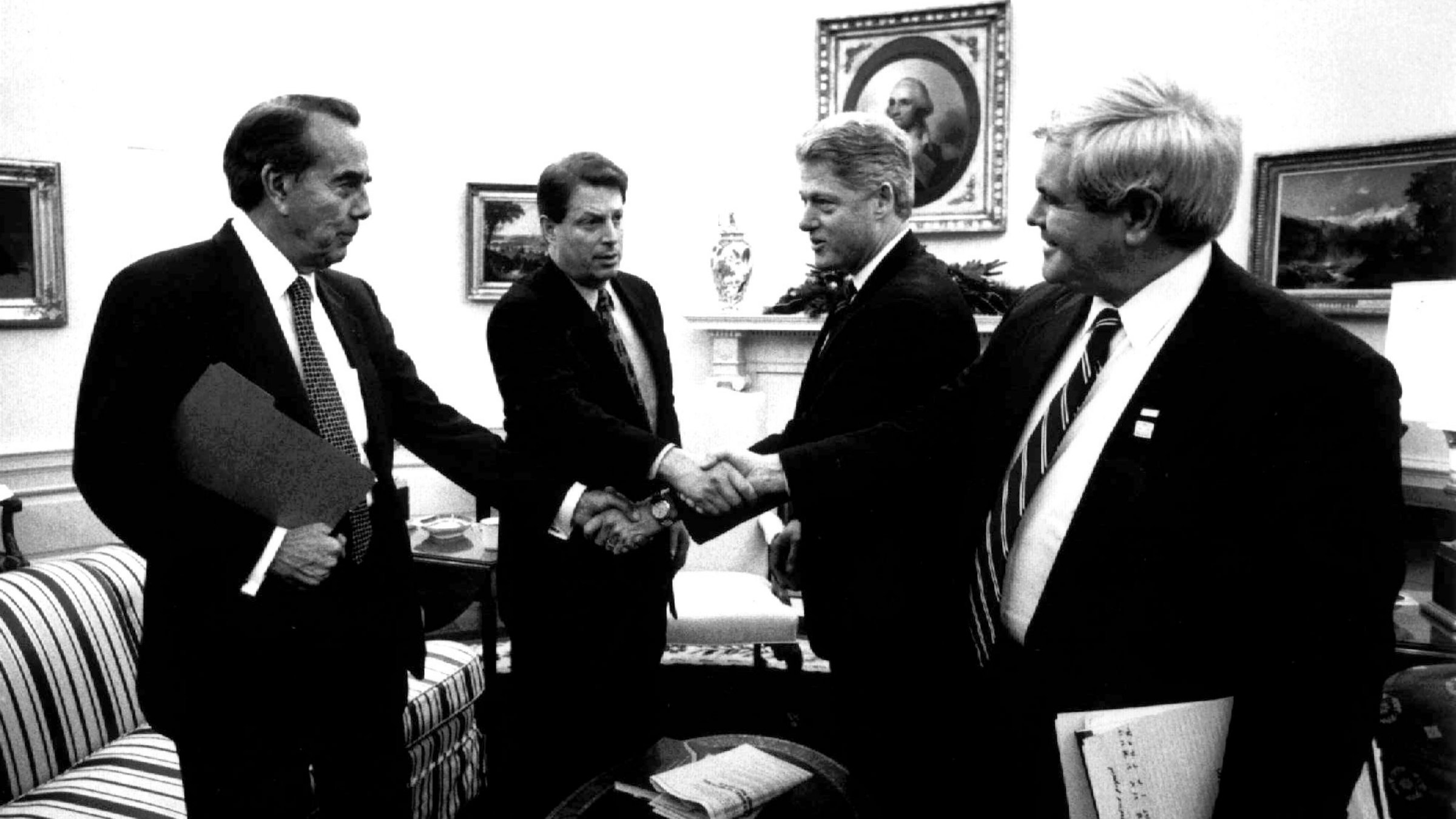 Republican Senate leader Bob Dole, Democratic Vice President Al Gore, Democratic President Bill Clinton and Republican Speaker of the House Newt Gingrich perform a complicated fiscal handshake. Those were the days...