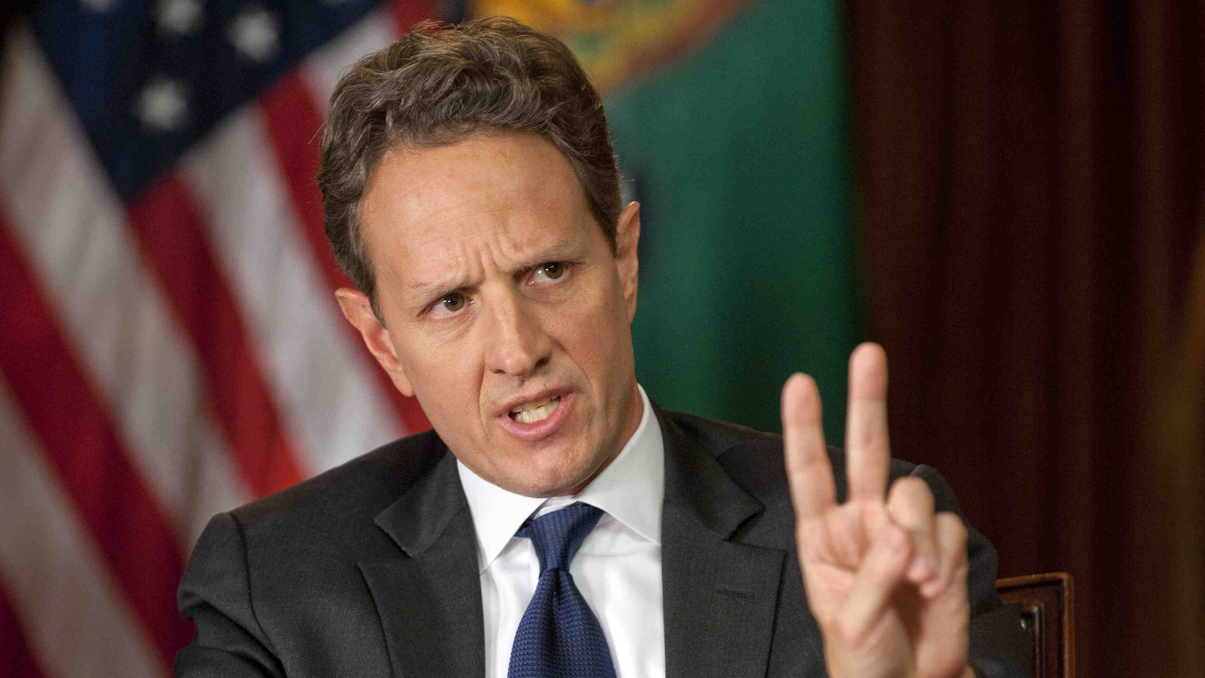 "In this Nov. 30, 2012, photo provided by CBS News Treasury Secretary Timothy Geithner answers questions about averting the ""fiscal cliff"" on an episode of  ìFace the Nationî on Sunday, Dec. 2, 2012  Geithner said Republicans have to stop using fuzzy ìpolitical mathî and say how much they are willing to raise tax rates on the wealthiest 2 percent of Americans and then specify the spending cuts they want. (AP Photo/CBS News, Chris Usher)"