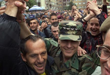 NATO Supreme Commander Wesley Clark is welcomed in Kosovo in 1999; will he find a lucrative business deal there today?