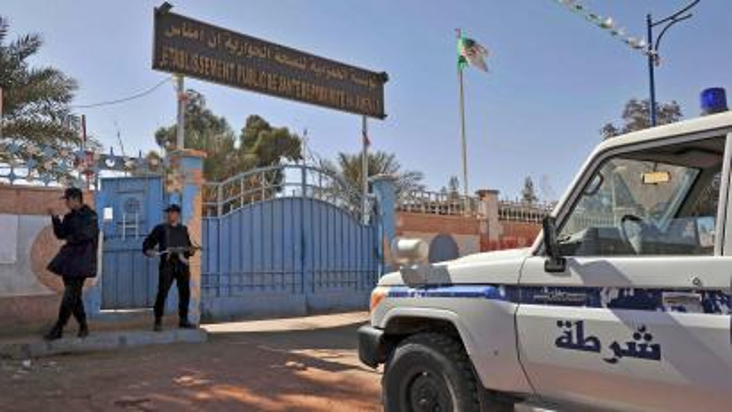 Algerian police outside a hospital at Ain Amenas