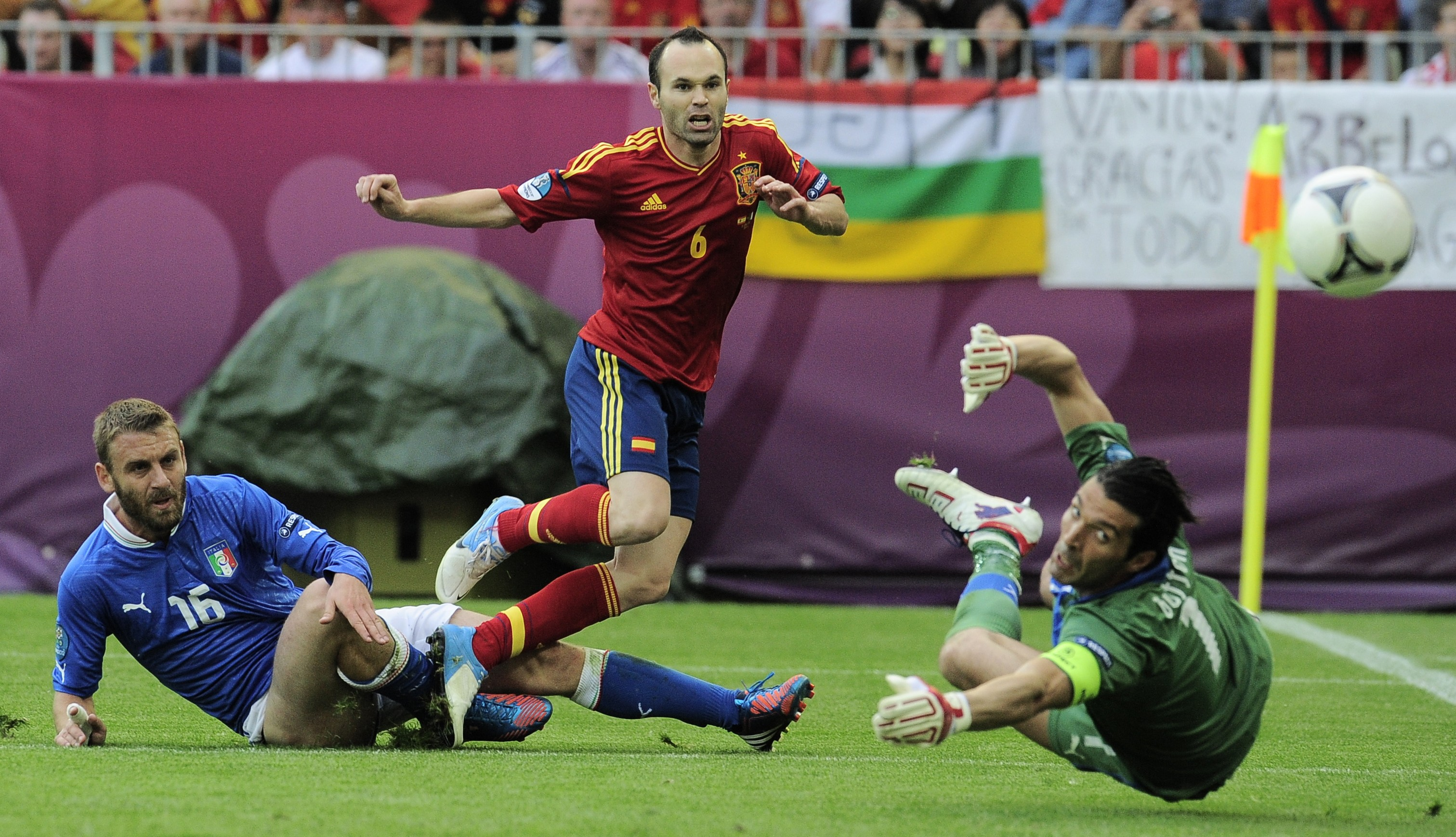 Spain's Andres Iniesta fails to score past Italy's Daniele De Rossi, left, and Italy goalkeeper Gianluigi Buffon, right, during the Euro 2012 soccer championship Group C match between  Spain and Italy in Gdansk, Poland, Sunday, June 10, 2012. (AP Photo/Alvaro Barrientos)