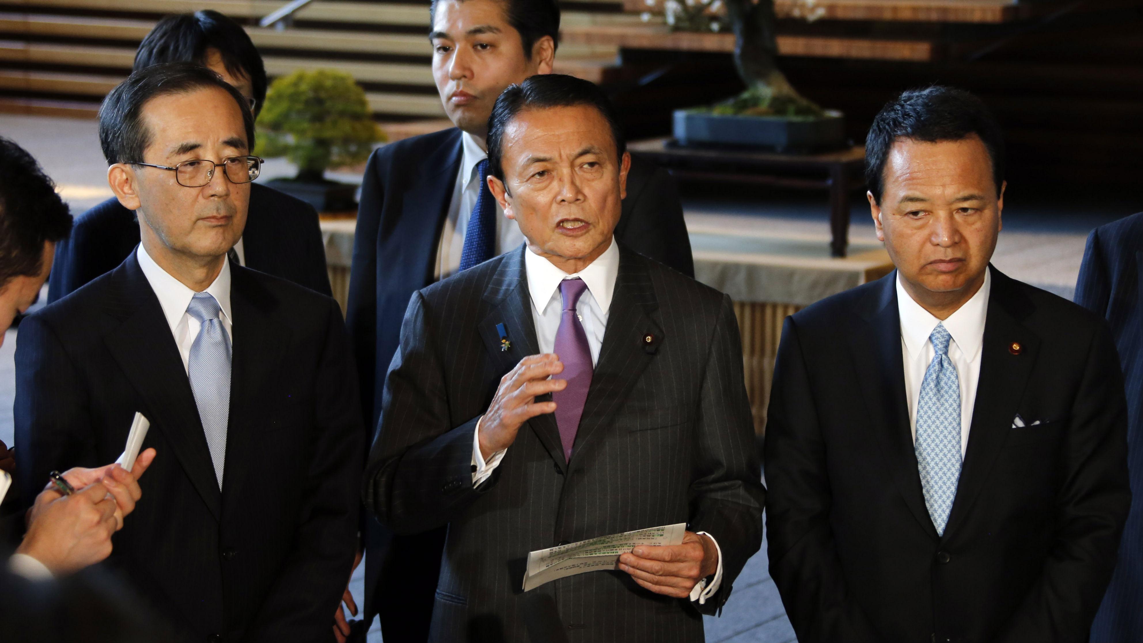 Not so radical: Japan's Finance Minister Taro Aso (center), along with Economics Minister Akira Amari (right) and Bank of Japan Gov. Masaaki Shirakawa (left)