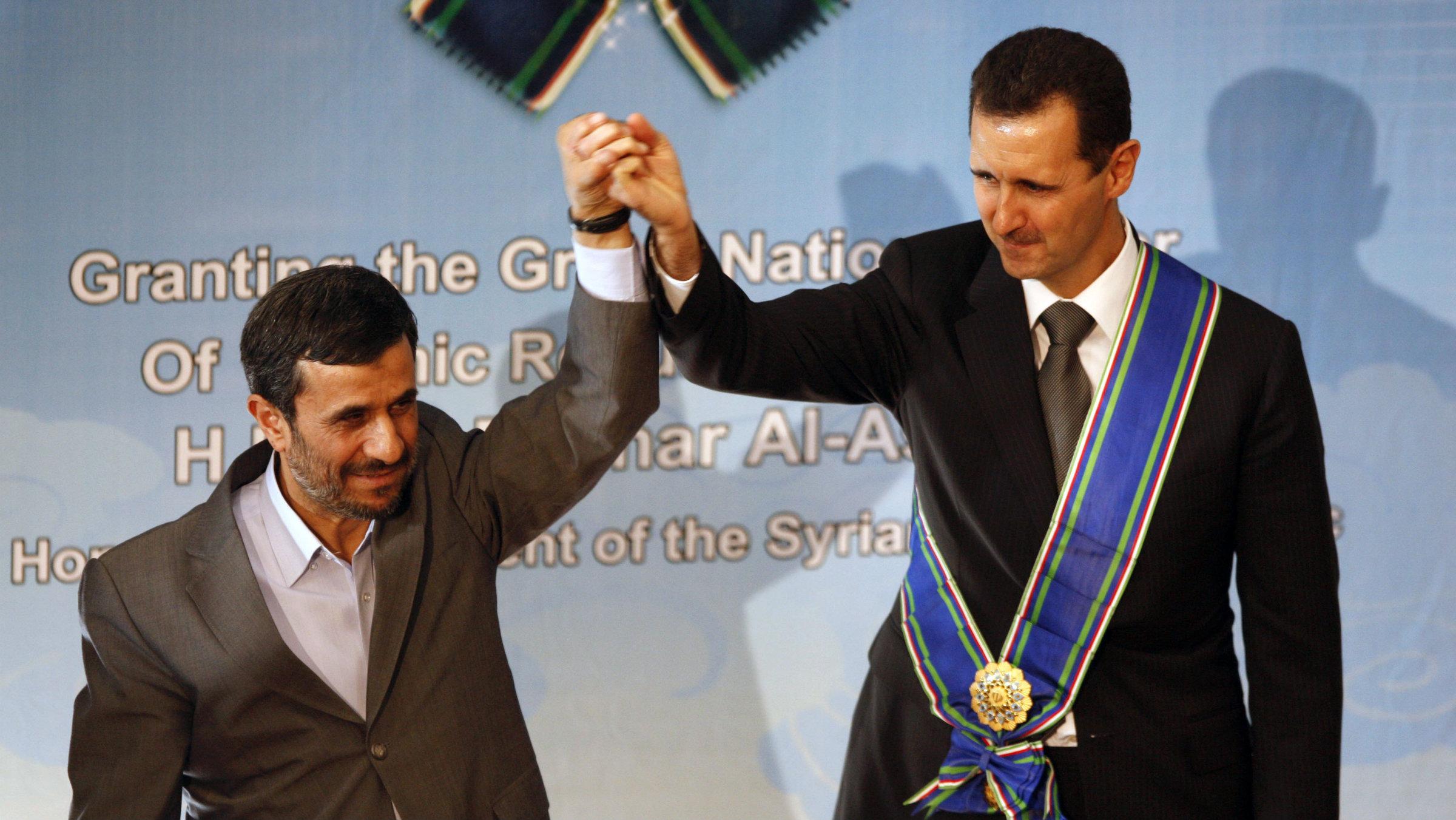 Iran's Mahmoud Ahmadinejad, left, and Syria's Bashar Assad
