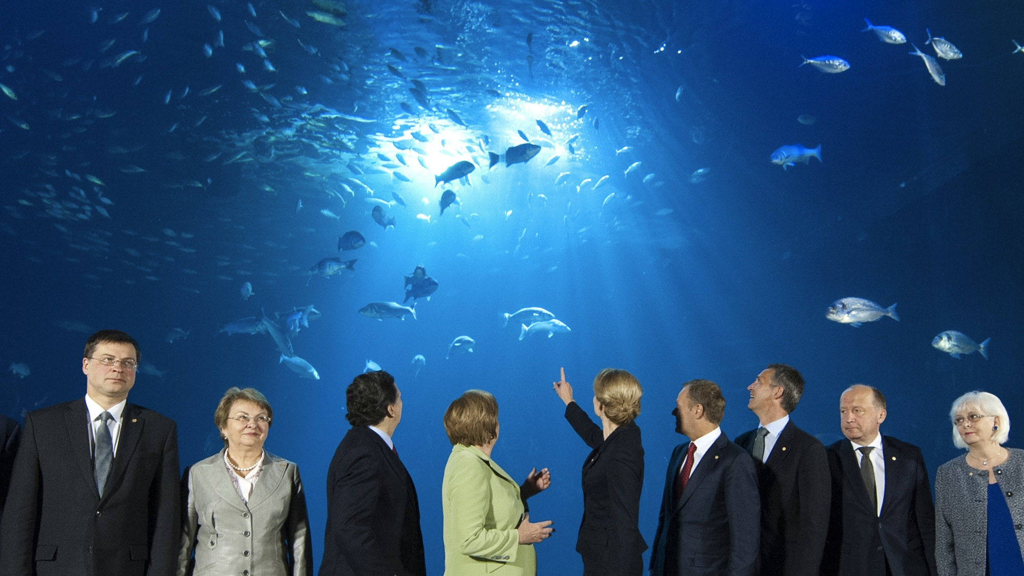 The members of the Council of the Baltic Sea States pose front of a giant aquatic tank at the Ozeaneum sea museum for the family photo at their summit in Stralsund, Germany, Thursday, May 31, 2012. From left: Latvia's Prime Minister Valdis Dombrovskis, Chairman of the Baltic Sea Parliamentary Conference Valentina Pivnenko, President of the European Commission  Jose Manuel Barroso, German Chancellor Angela Merkel, Denmark's Prime Minister Helle Thorning-Schmidt, Poland's Prime Minister Donald Tusk, Norway's Prime Minister Jens Stoltenberg, Lithuania's Prime Minister Andrius Kubilius and Iceland's  Prime Minister Johanna Sigurdardottir. (AP Photo/Jens Meyer)