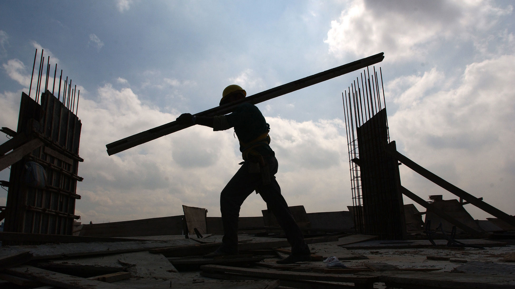 A construction worker carries a beam at the top of a building in Sao Paulo, Brazil, on Tuesday, September 30, 2003. Brazil's economy will probably grow less than 1 percent this year, representing the worst performance for South America's largest country in five years, according to the Central Bank. The growth forecast was a revision of a previous estimate predicting anemic 1.5 percent for this year, the same as last year's rate. If the more pessimistic forecast proves true, this year would be the mostdismal for Brazilian economic growth since 1998.