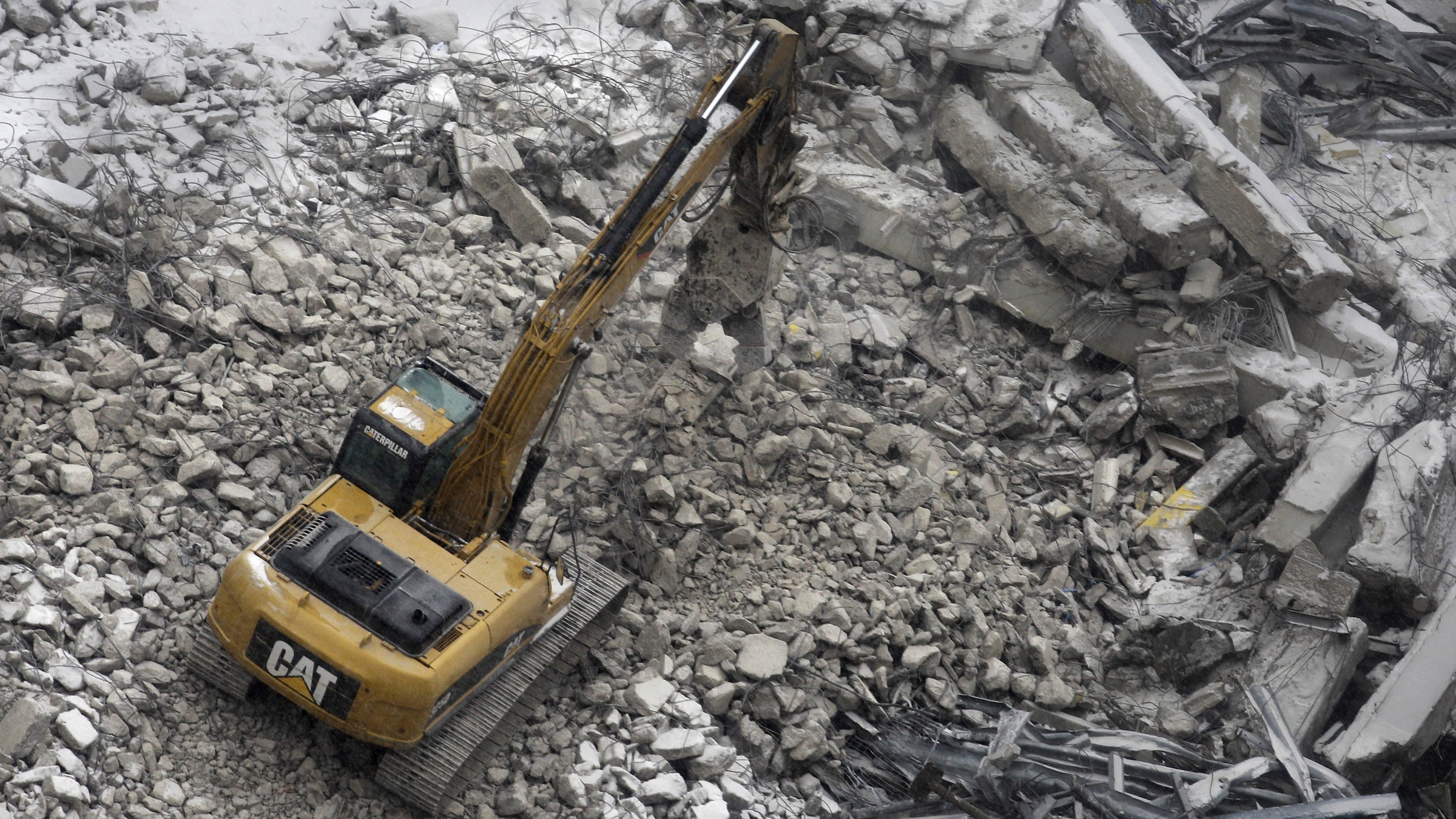 In this Friday, Jan. 14, 2011 photo, a Caterpillar ditch digger works at the site of the the $465 million medical mart complex in Cleveland. Caterpillar said Thursday, Jan. 27, 2011 that the company more than quadrupled its fourth-quarter profit as stronger demand helped increase global sales of mining and construction equipment. (AP Photo/Amy Sancetta)