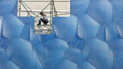 A worker at a high-tech expo in China. US immigration reform needs to remove hurdles to bring in foreign talent.