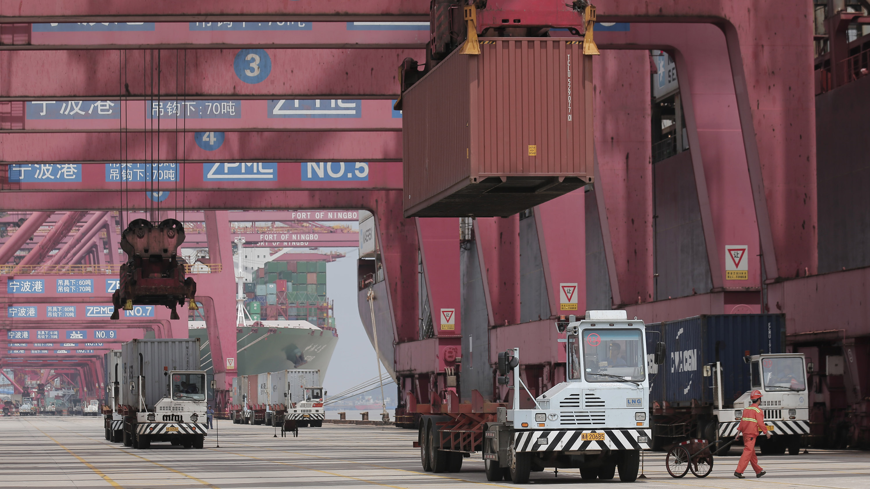 Chinese container ships being loaded for trade