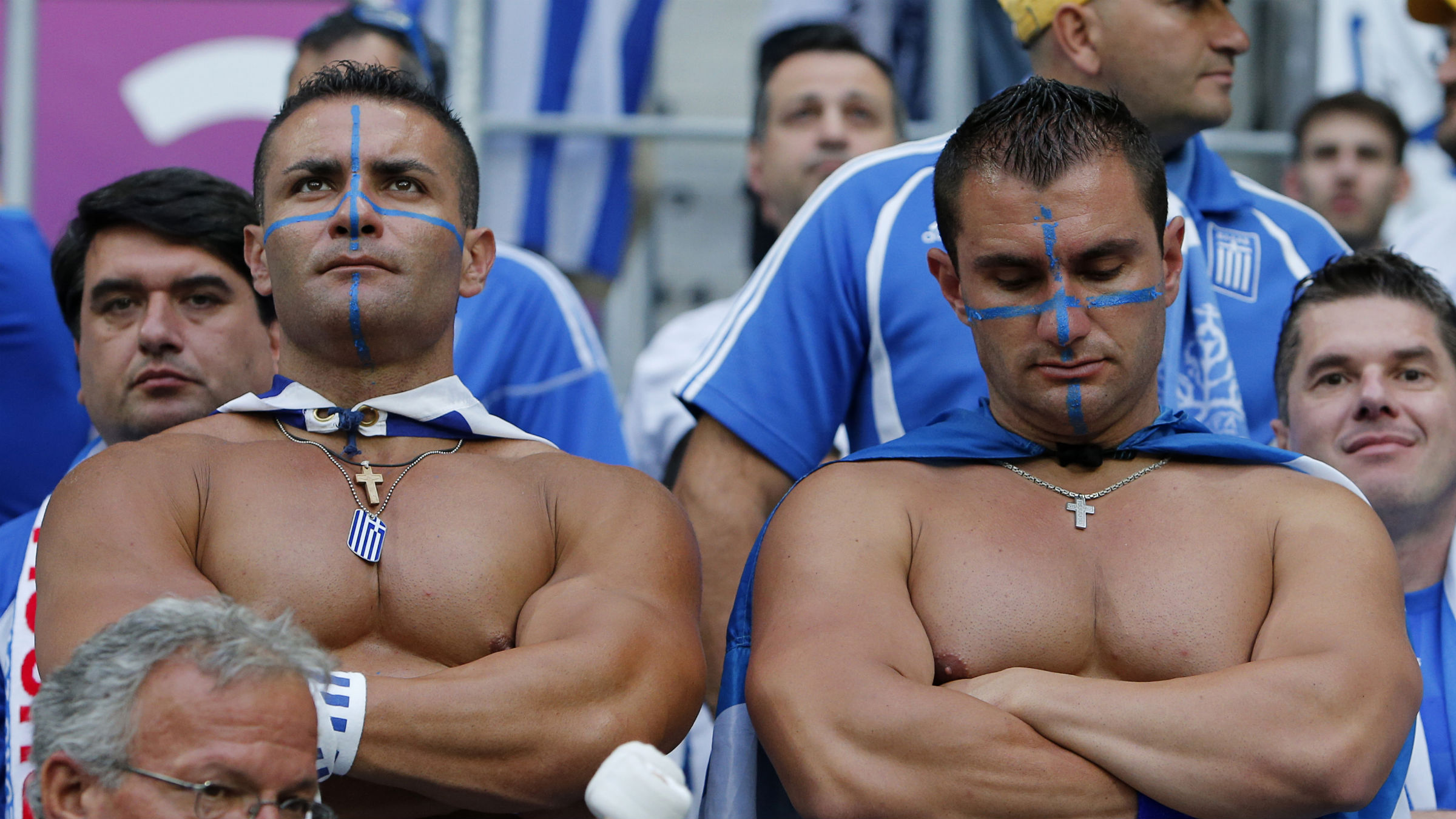 Greek fans stand dejected after the Euro 2012 soccer championship Group A match between Greece and Czech Republic in Wroclaw, Poland, Tuesday, June 12, 2012. Greece lost the match 1-2.