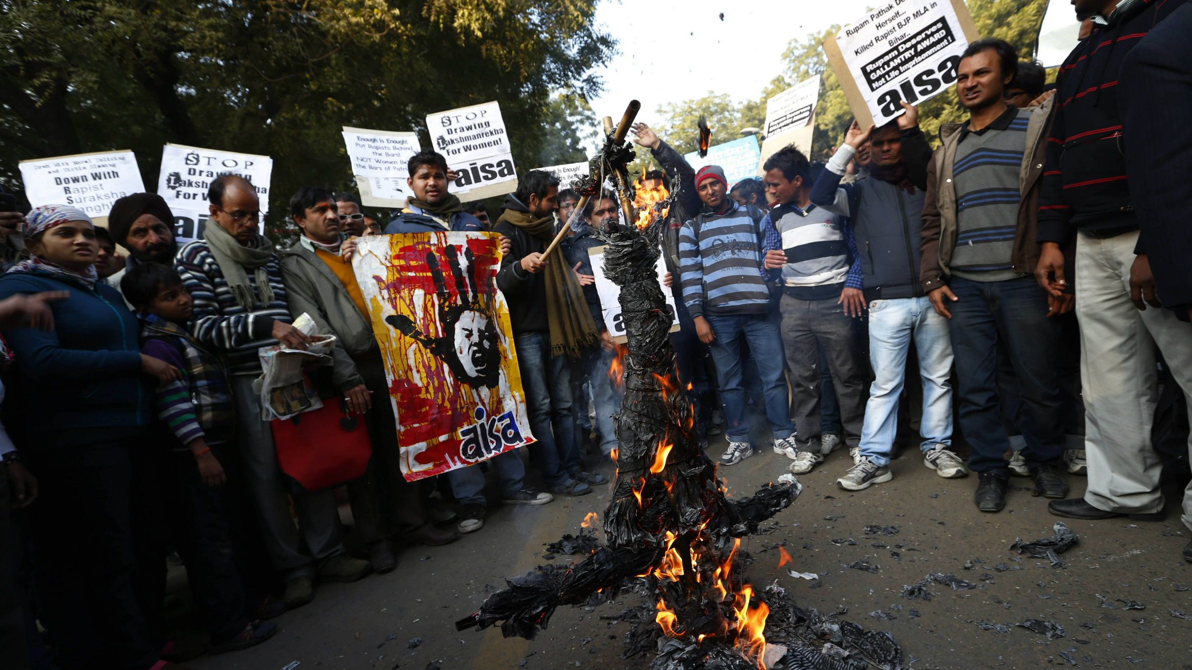 Foot in mouth: Indian students burn an effigy representing Hindu nationalist leaders Asaram Bapu and Mohan Bhagwat. This week, Bapu said the victim of the Delhi gang rape was equally responsible for the attack as her assailants. Bhagwat also made several derogatory statements against women.