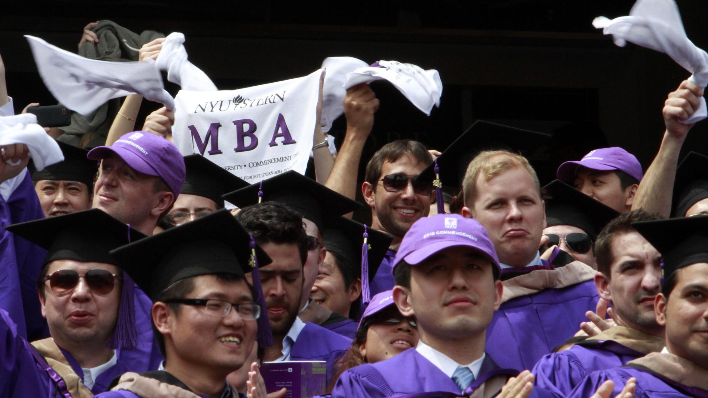 cheering MBA graduates