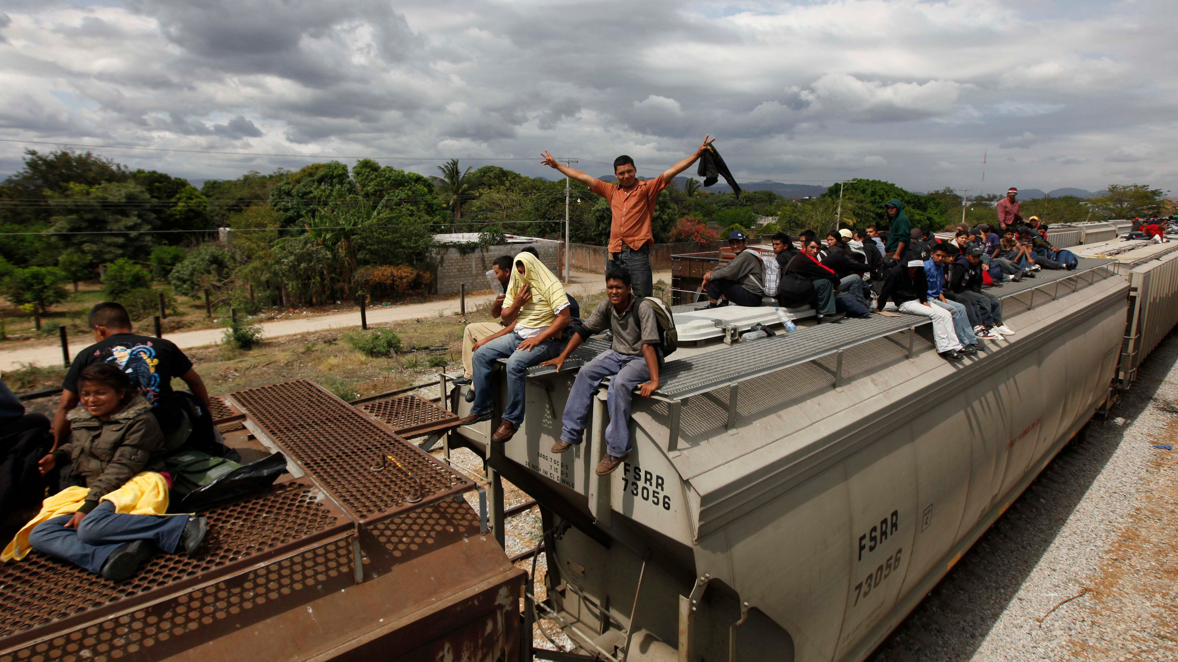 Migrants ride on top of a northern bound train toward the US-Mexico border in Ixtepec, in Oaxaca, southern Mexico, Thursday, March 10, 2011.