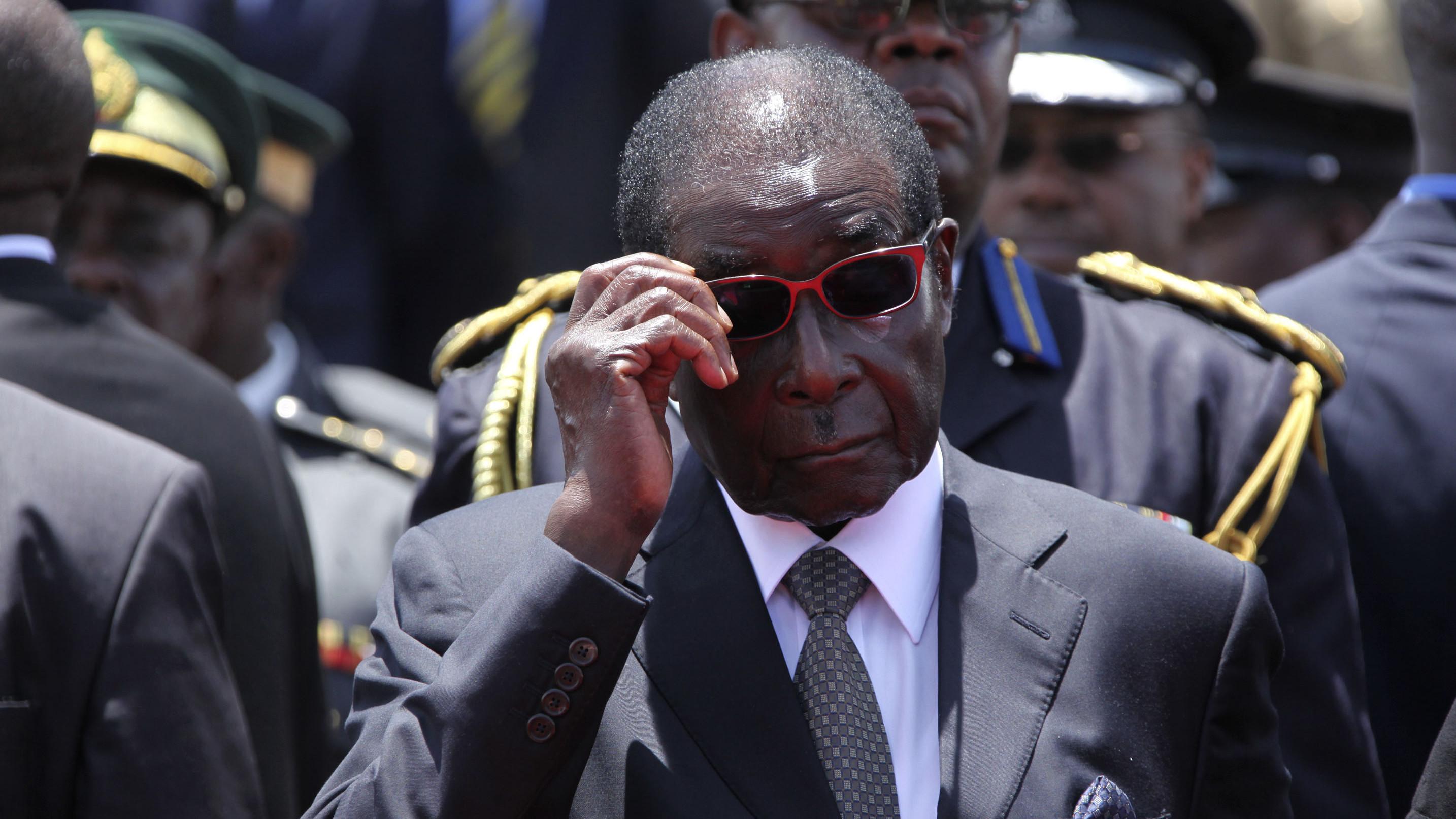 Zimbabwean President Robert Mugabe, attends the burial of Deputy President John Nkomo, at the Heroes Acre, in Harare, Zimbabwe, Monday, Jan, 21, 2013.