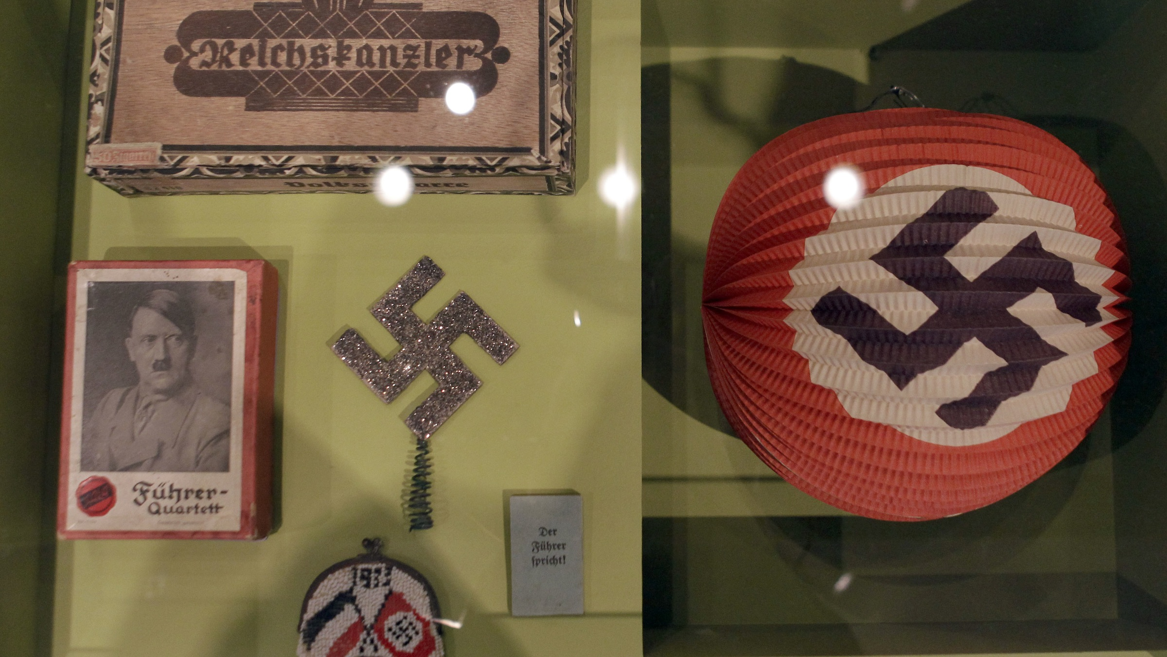 Various Nazi paraphernalia like cigars, a lampion, a wallet and a quartet decorated with a swastika are pictured during a preview for the exhebition 'Hitler and the Germans - nation and crime' in Berlin, Germany, Wednesday, Oct. 13, 2010. The exhibition runs from Oct. 15, 2010 until Feb. 6, 2011. (AP Photo/Michael Sohn)