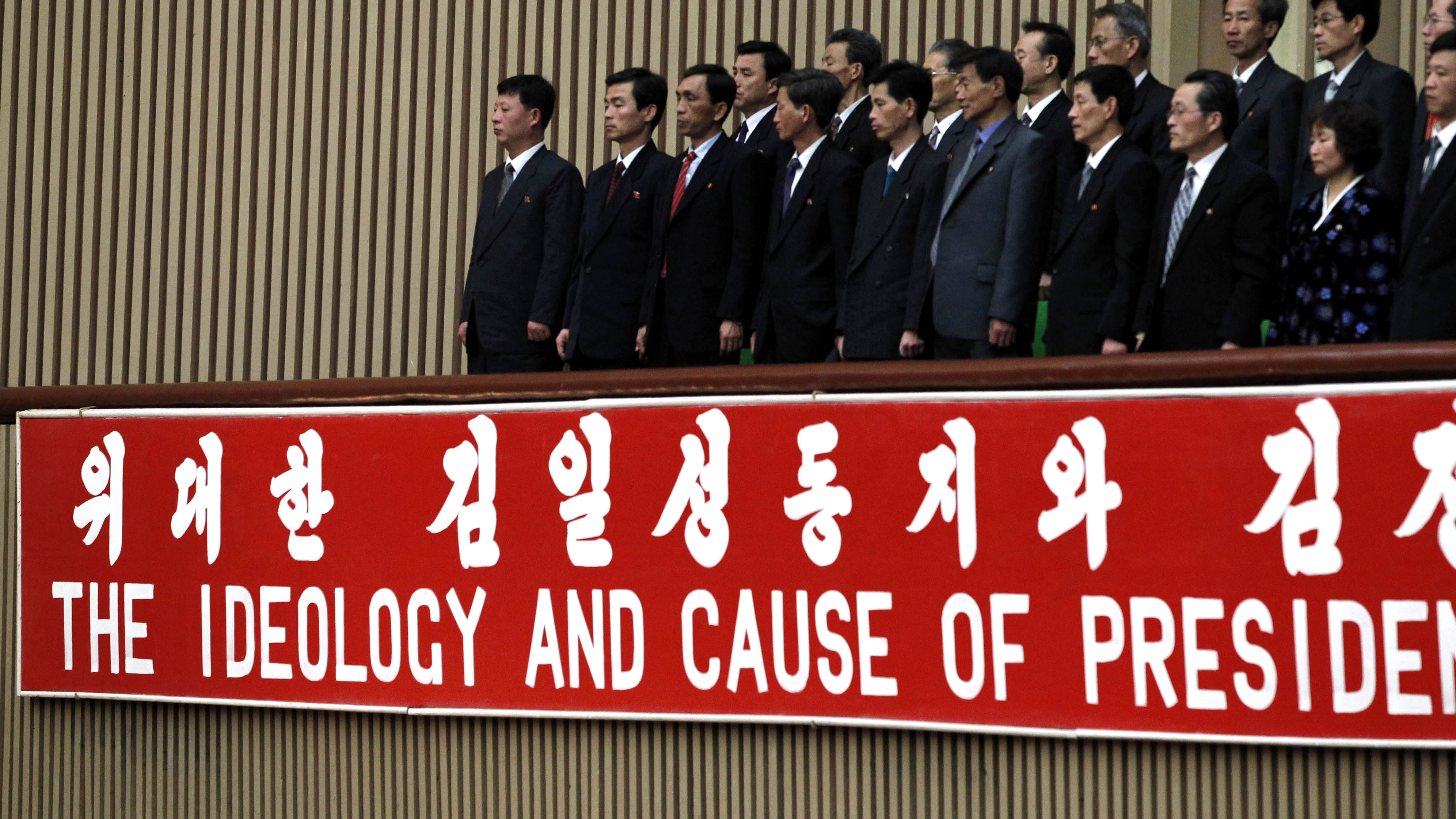 """Participants stand during the World Congress on the Juche Idea held in Pyongyang, North Korea, Thursday, April 12, 2012. """"Juche,"""" or """"self-reliance,"""" is philosophy of North Korean founder Kim Il Sung whose 100th anniversary of the birth is marked on Sunday, April 15."""