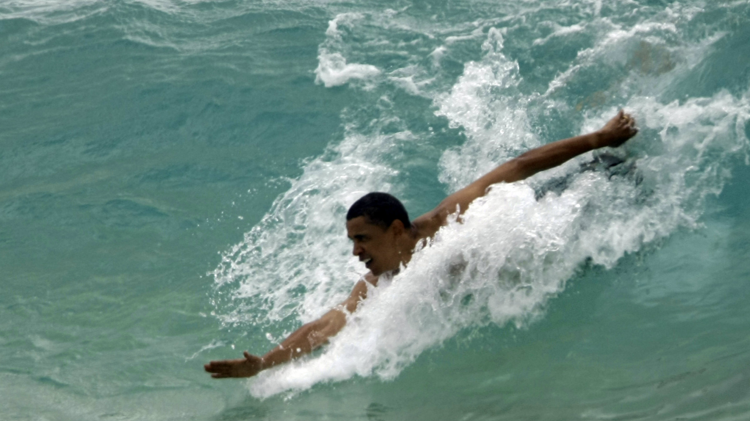 Rougher waters this time? President Obama bodysurfing during a previous vacation in Hawaii. He headed back there tonight after a fiscal cliff was averted—but it's hardly smooth sailing for markets and the economy now.