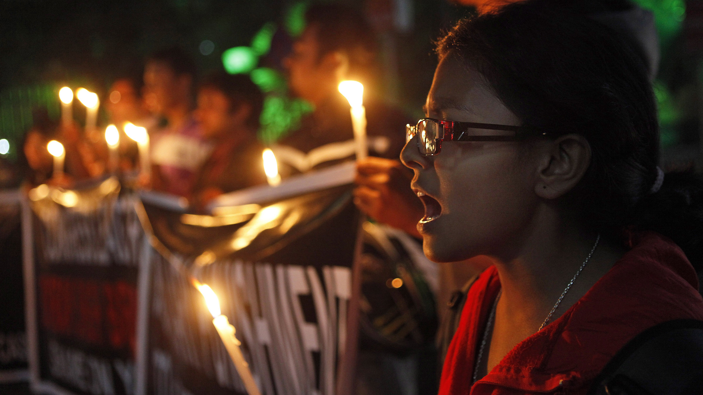 Never forget: A woman holds vigil in memory of a 23-year-old student who was gang raped last month on a moving bus in Delhi.